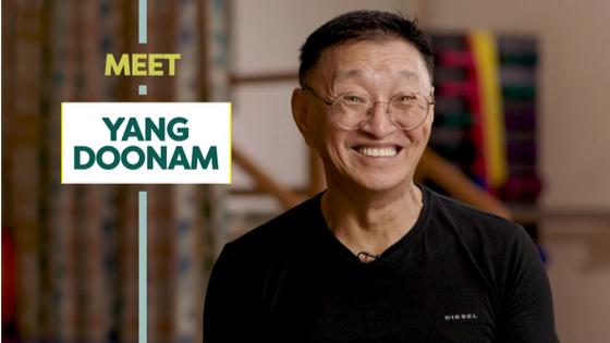 Mr. Yang smiling