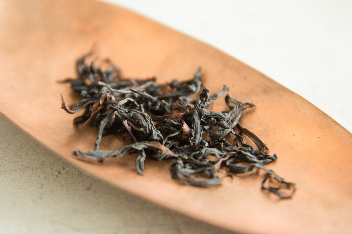 """Black tea from wild trees in Yunnan province. Yap finds this popular amongst ladies – with citrus notes of mangoes, lychees, watermelon, berries, """"a potpourri of fruits!"""". The magic is found in this – no one understands where the fruity tones are from, for the tree has been there for centuries in the wild, and there are no fruit plantations nearby."""