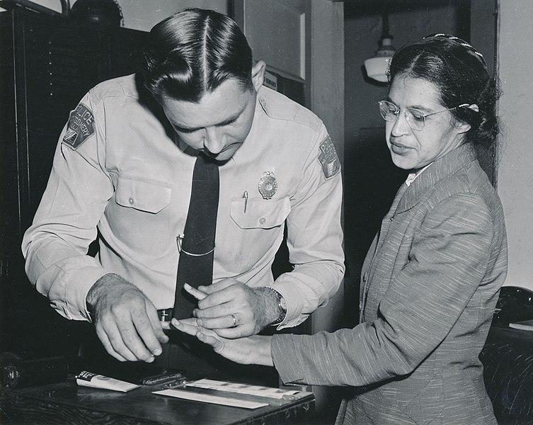 753px-Rosa_Parks_being_fingerprinted_by_Deputy_Sheriff_D.H._Lackey_after_being_arrested_for_boycotting_public_transportation_-_Original.jpg