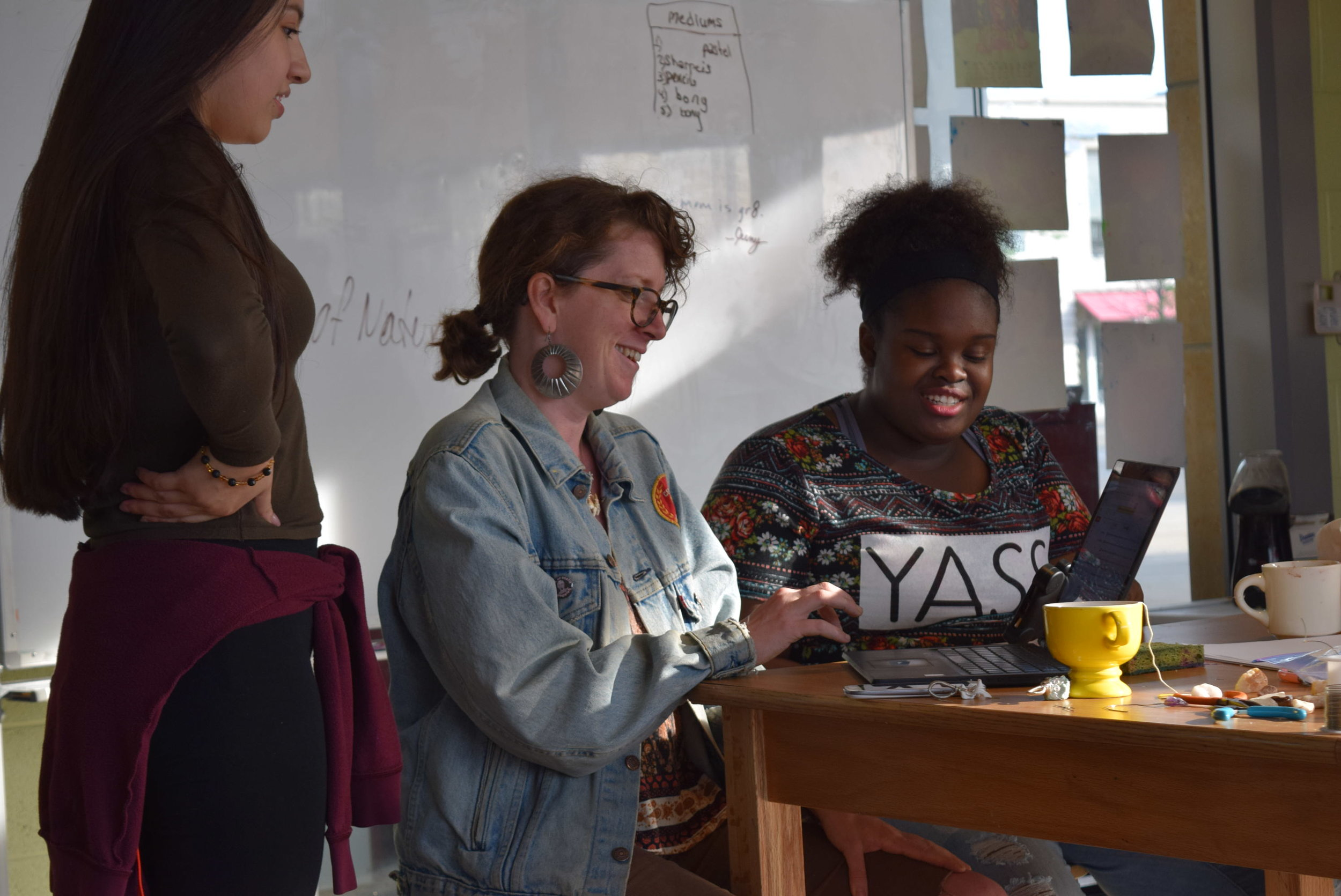 Teaching Artist Maggie McGuire works with teens on social media videos in our Out-of-School Arts Program.