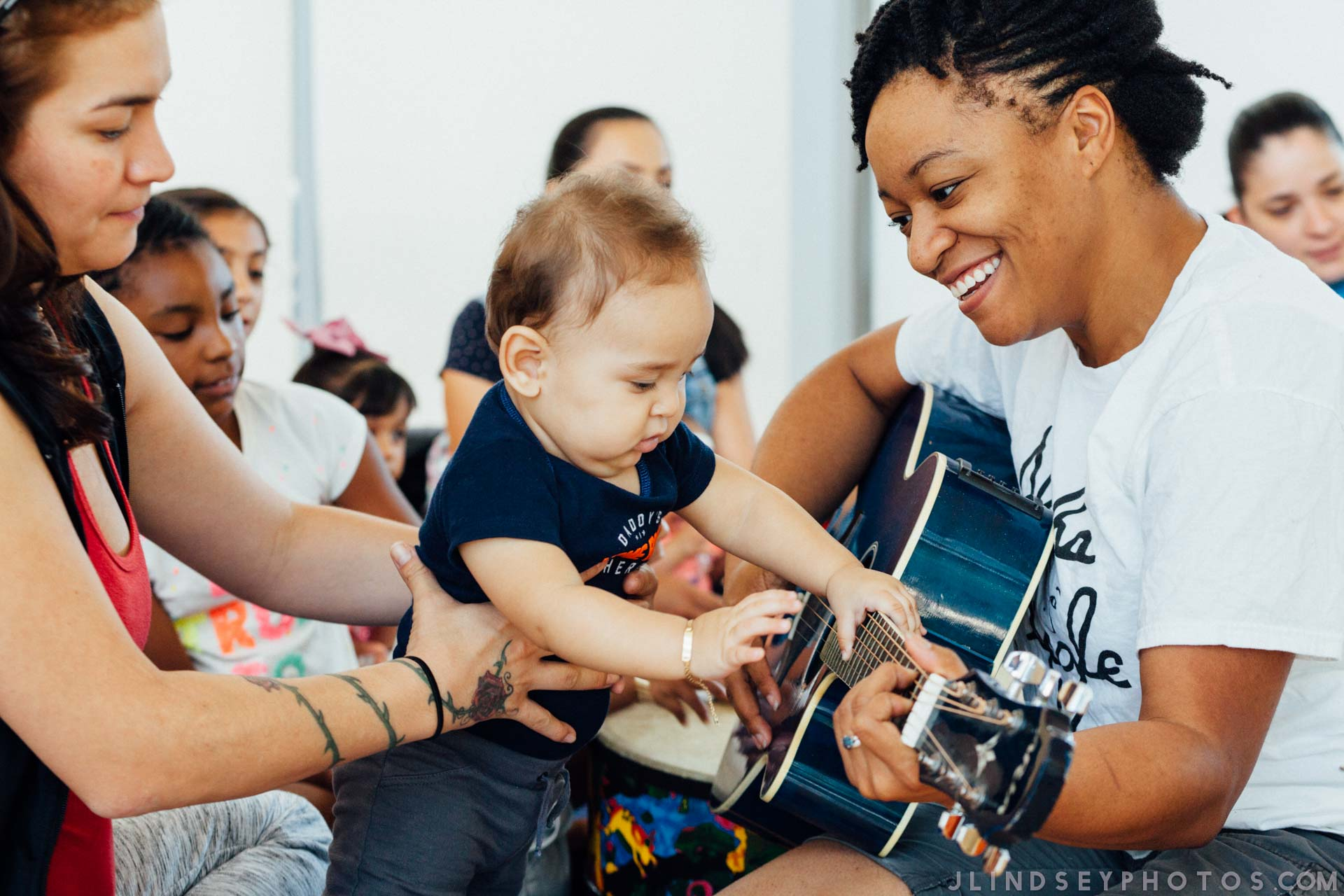 Teaching Artist Alesha Mickens uses music to engage young learners in a Living Arts' Detroit Wolf Trap Class. Photo by Julianne Lindsey.