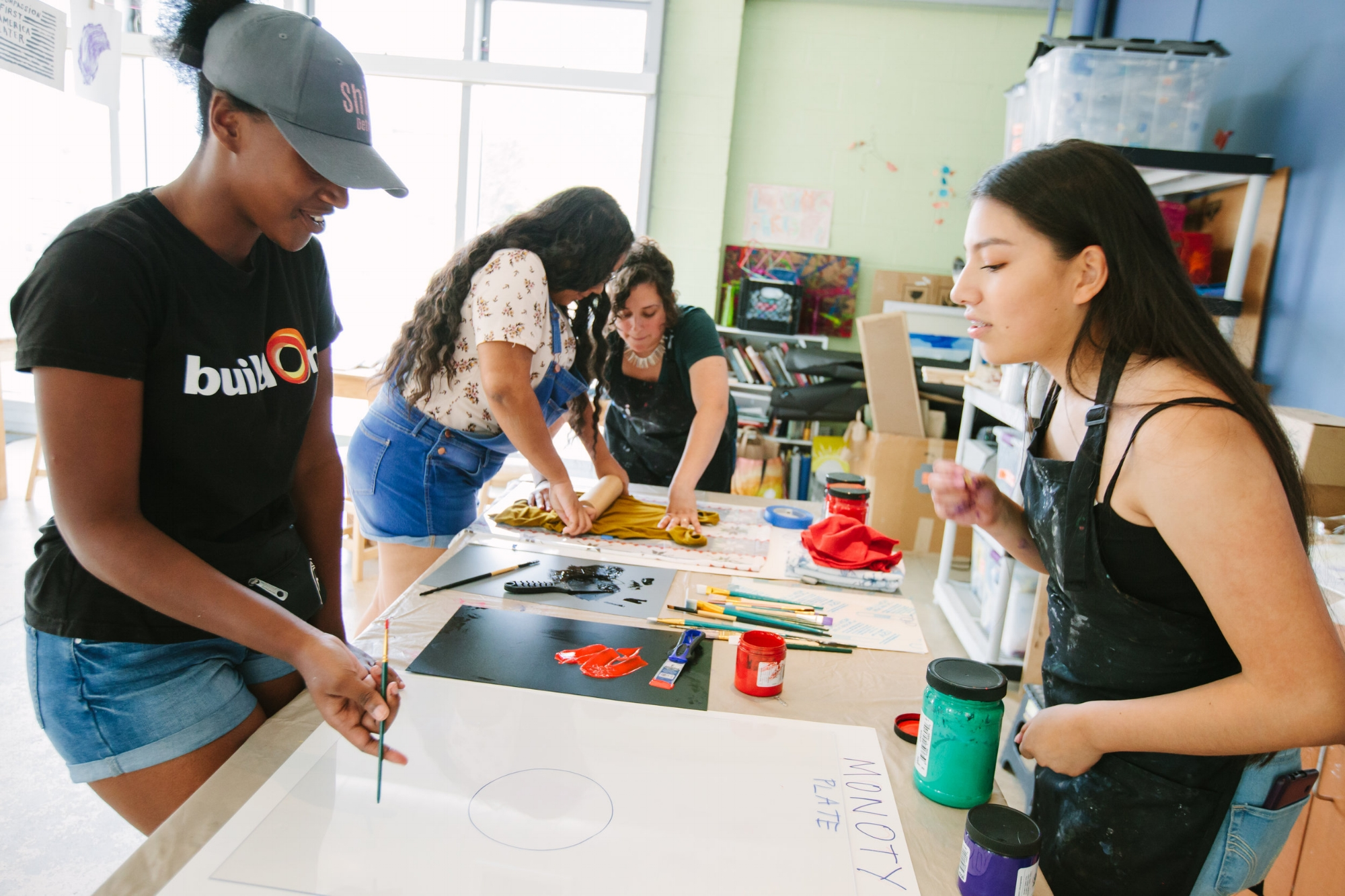 Students in a printmaking workshop at Open Arts Fest led by Director of Programs, Erika Villarreal Bunce.