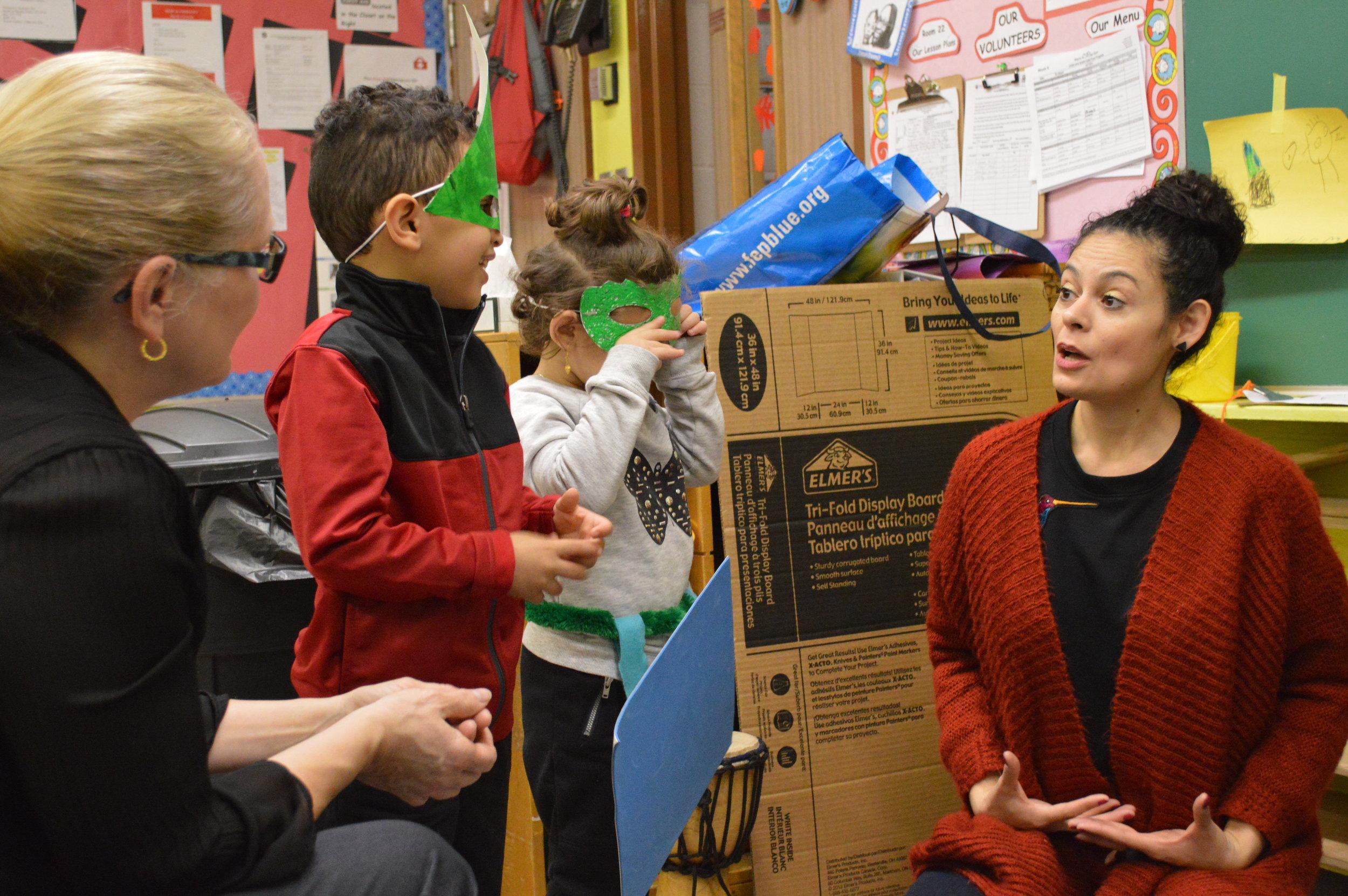 Detroit Wolf Trap Teaching Artist Karilú Alarcón Forshee provides arts-integrated professional development for a classroom teacher.