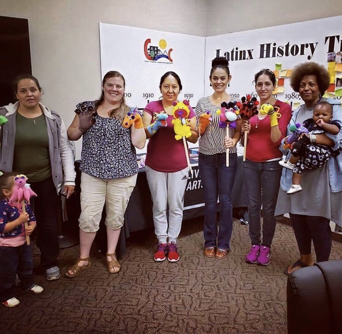 Teaching Artist Karilu Alarcon Forshee with participants in puppet workshop at Congress of Communities.