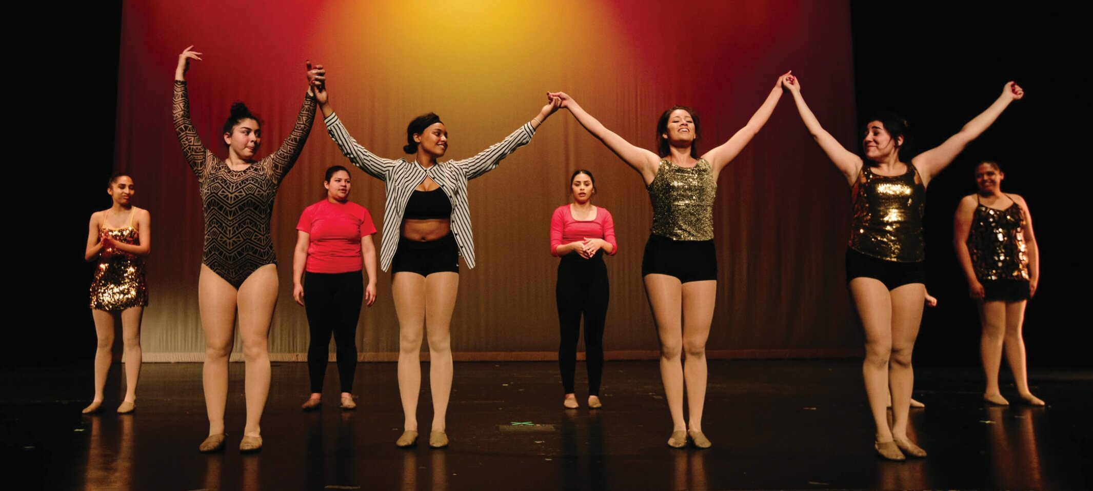 Senior dancers (front row, L-R) Andrea Hinojosa, Alexis Harris, Xalma Palomino, and Carolina Anaya, perform with the Youth Dance Ensemble at the 2019 Annual Student Showcase at Cass Technical High School.