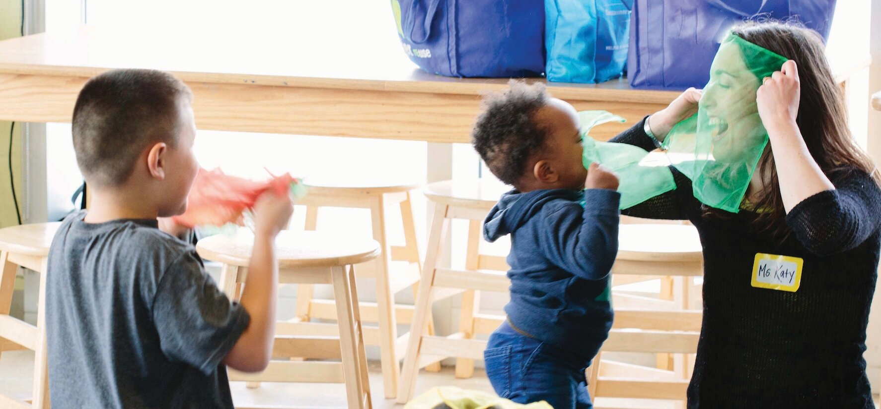 Teaching Artist Katy Schoetzow with toddlers in a Detroit Wolf Trap family class.