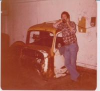 My dad, a business owner who preferred writing on walls. (Those are pencil marks behind him). I inherited both traits.