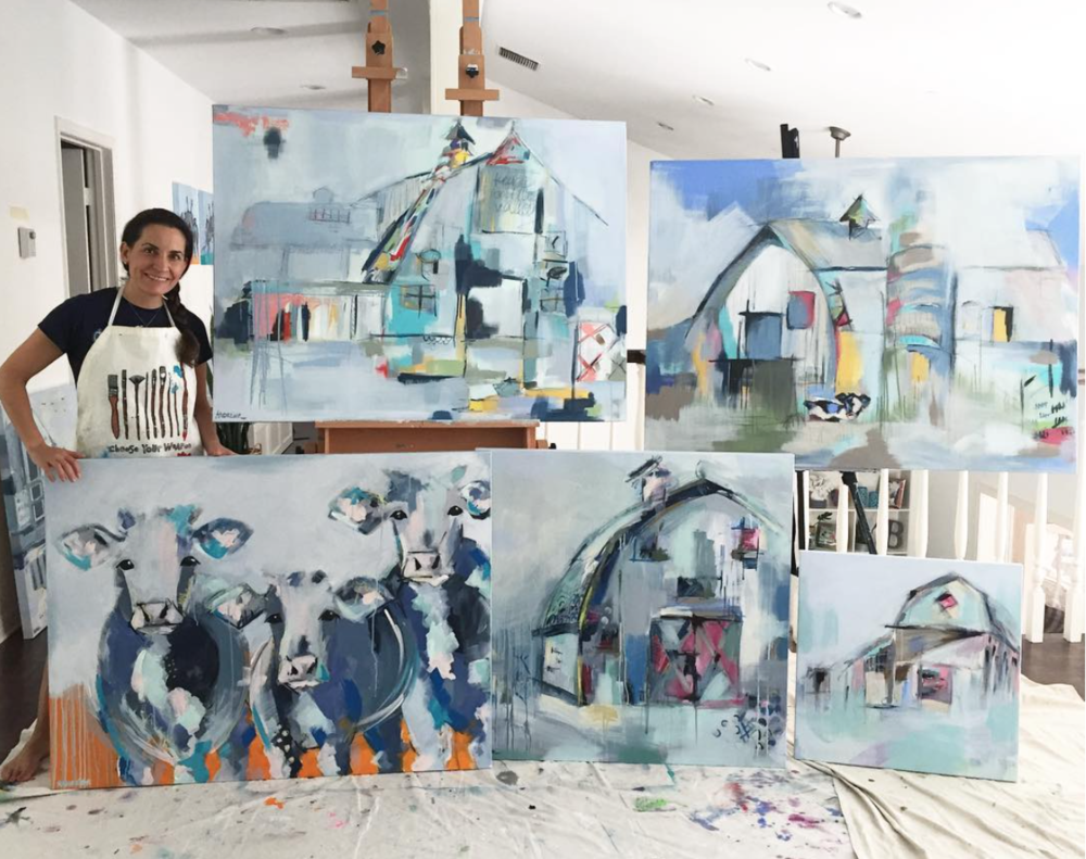 Andreina with some of her artwork before it is shipped off to galleries across the US.