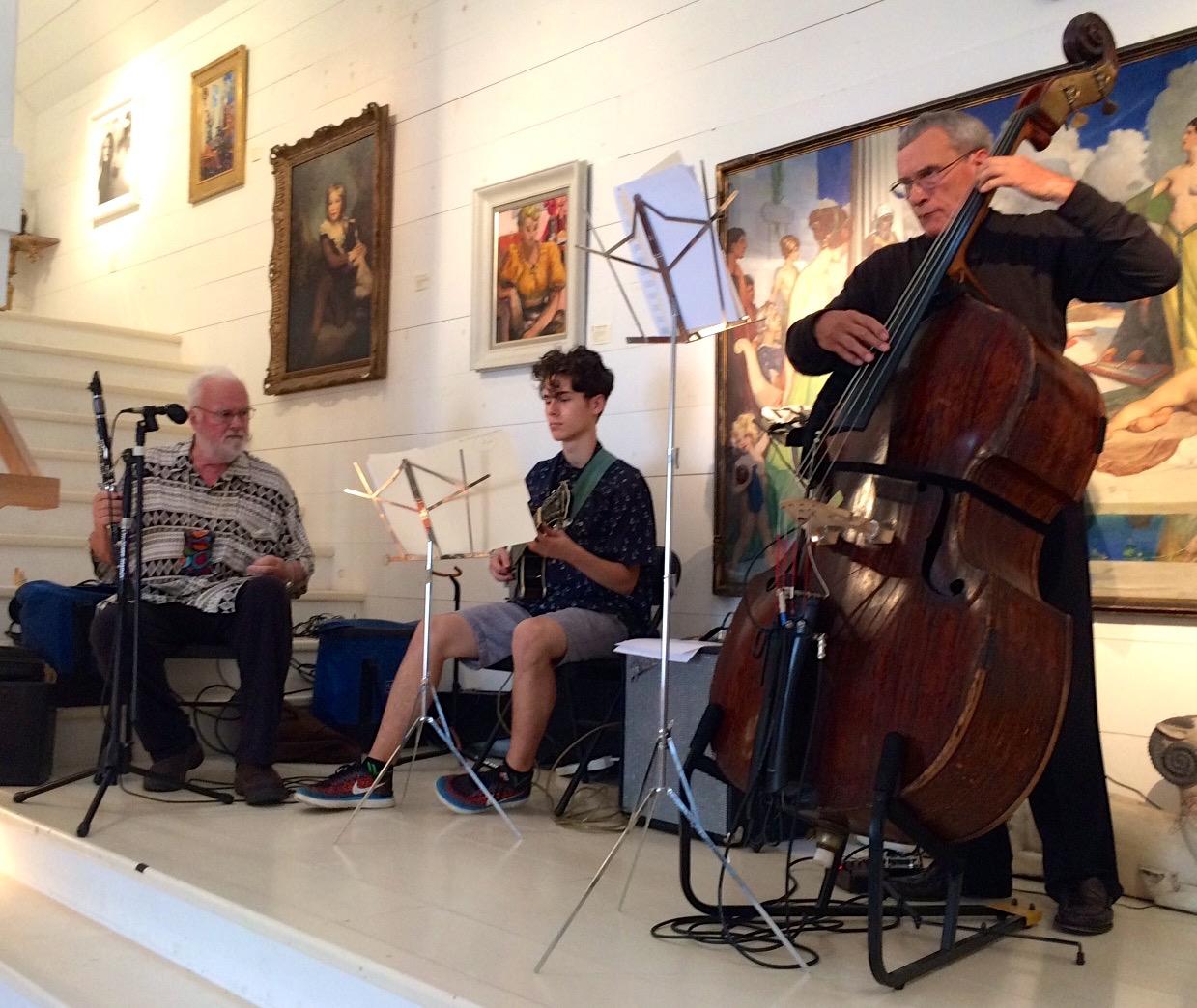 Brad Terry, Asa Waldo, and Vaughn DeForest play in WBG Modern Gallery during the August Wiscasset Art Walk.