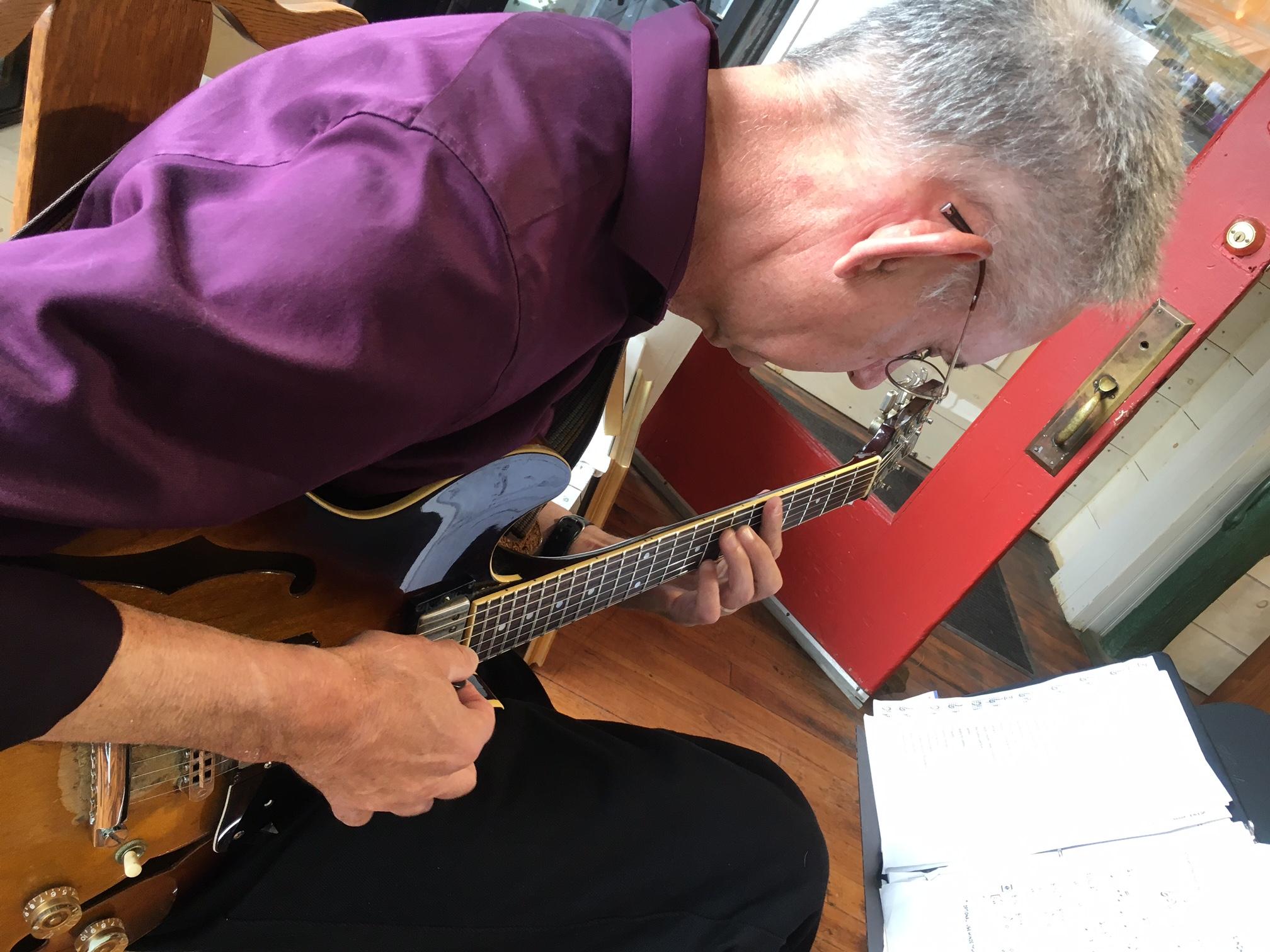 David Lawlor plays jazz guitar in Sylvan Gallery