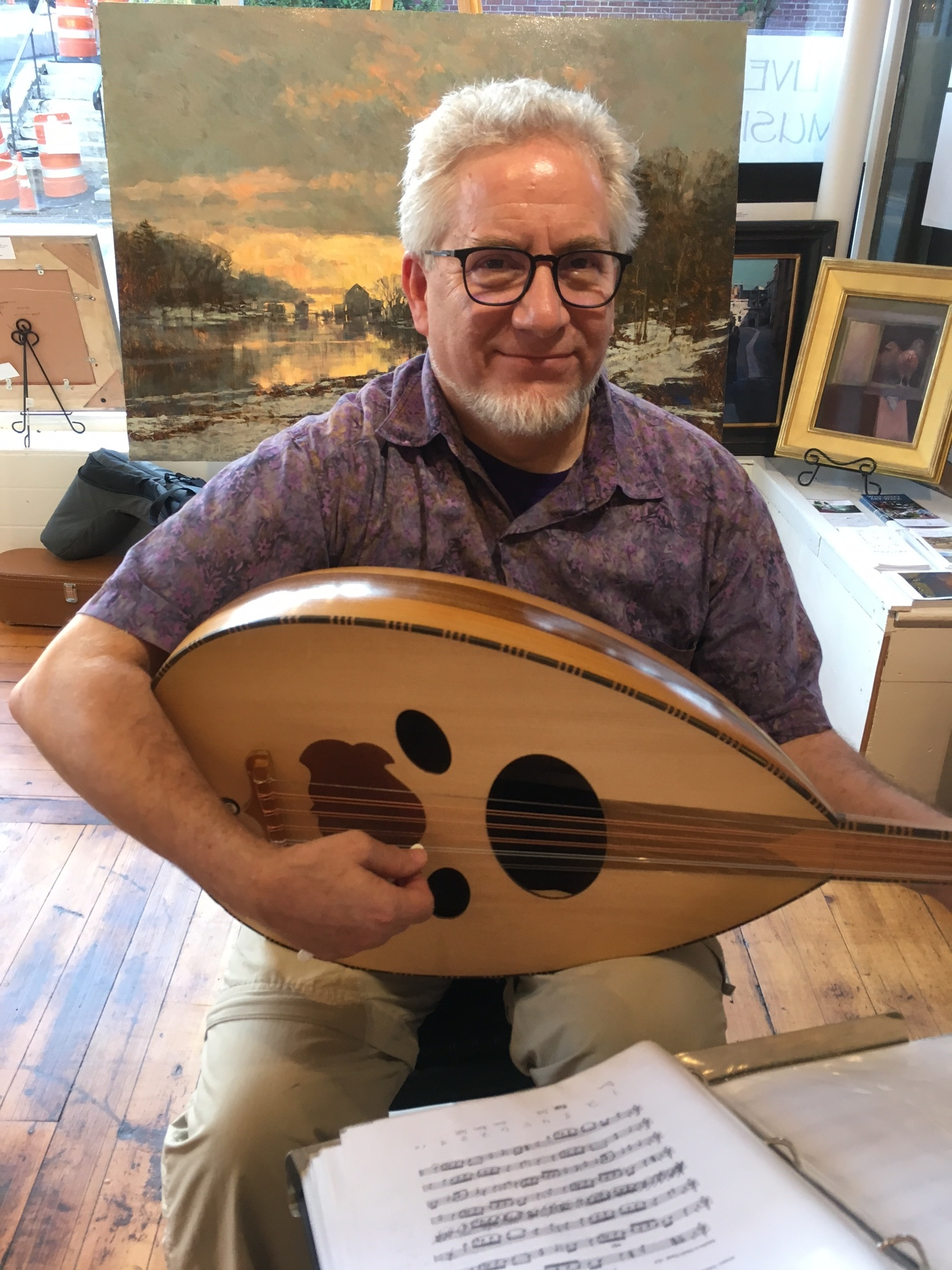 Jonathan Waldo plays classical guitar and oud in the galleries.