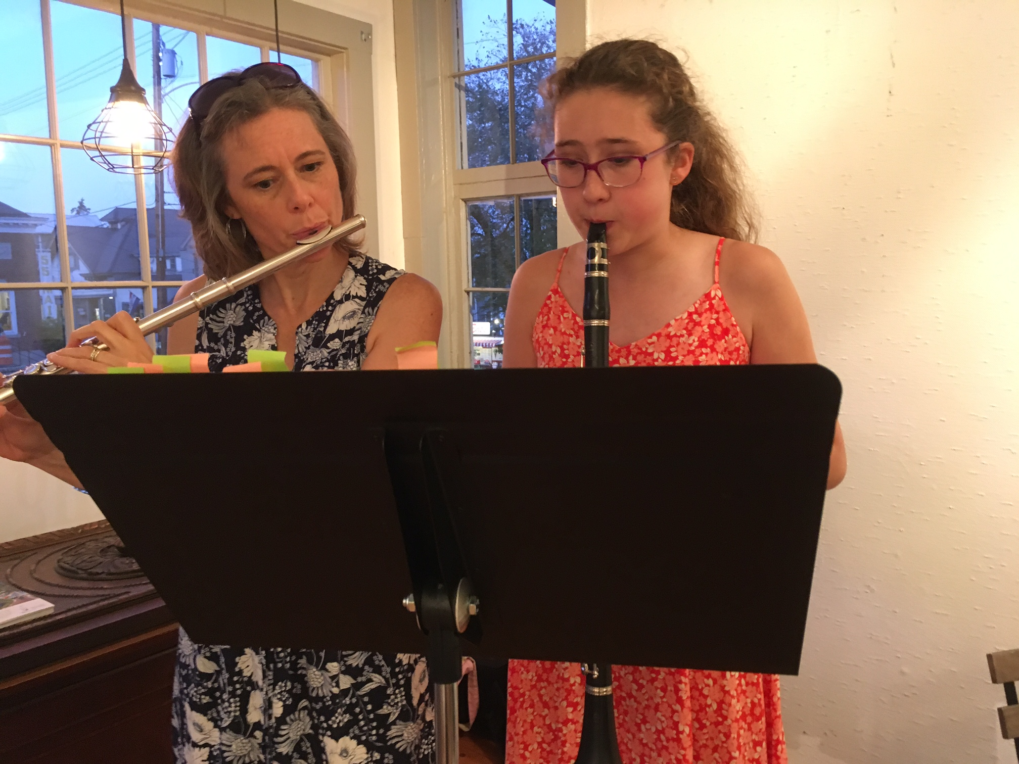 Lisa Truesdell on flute and daughter Julia on clarinet in the Weaving Project.