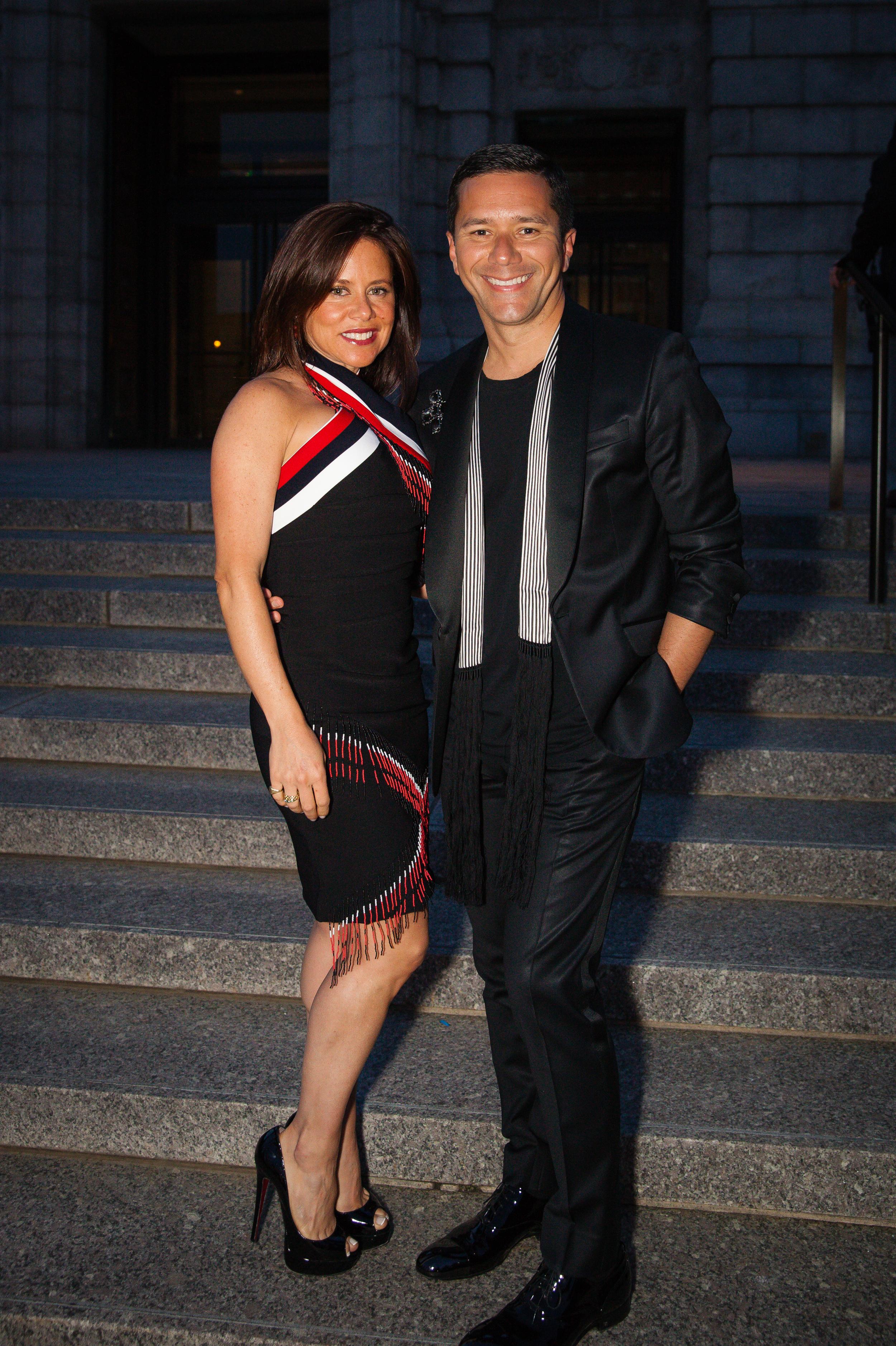 Daniela Corta and Ricardo Rodriguez~ On Daniela, Preen Dress. Preen heels. On Ricardo, Balmain tuxedo. Ann Demeulemeester scarf. Chanel brooch. Louis Vuitton shoes.