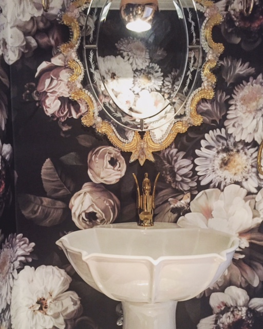 One side of the powder room
