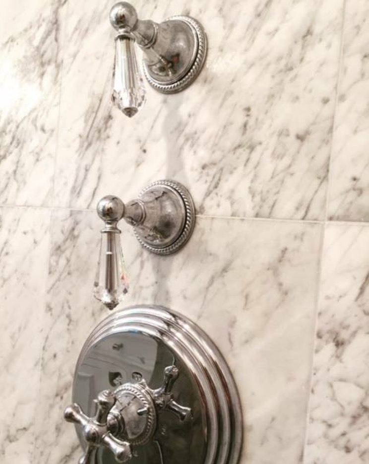 Crystal knobs against marble with chrome finish