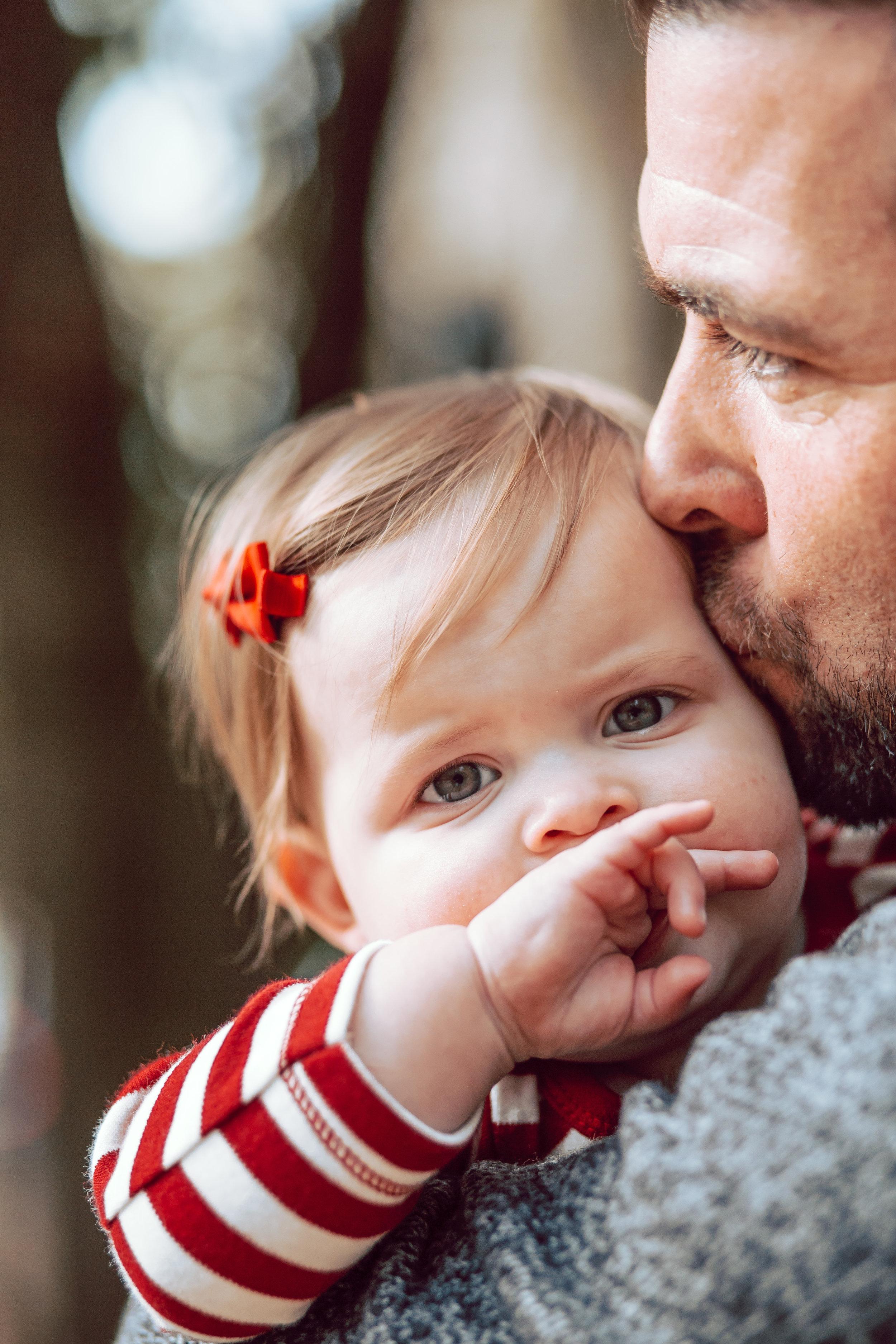 little girl eyes dad kissing cheek memphis