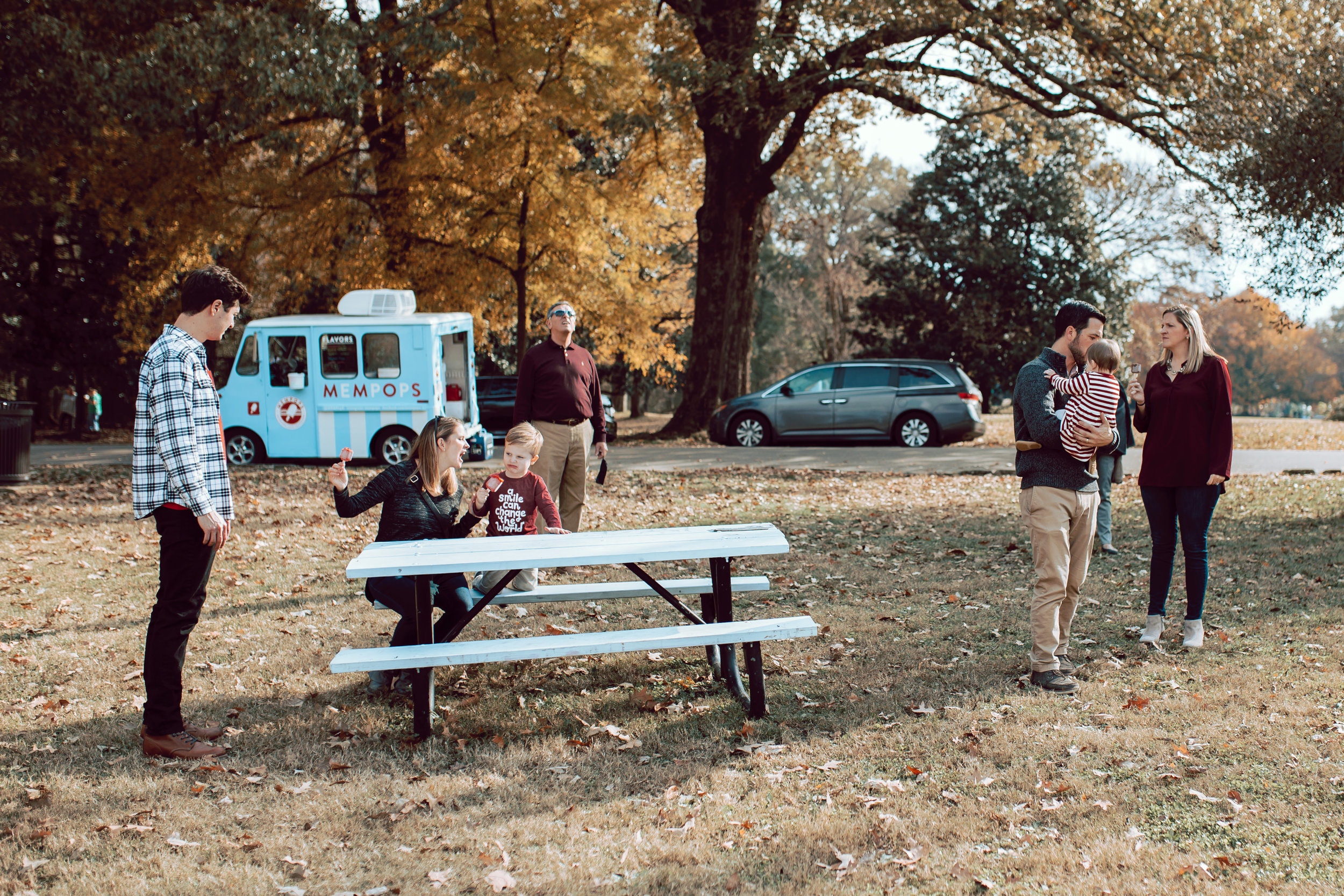 family hangs out in overton park in fall memphis