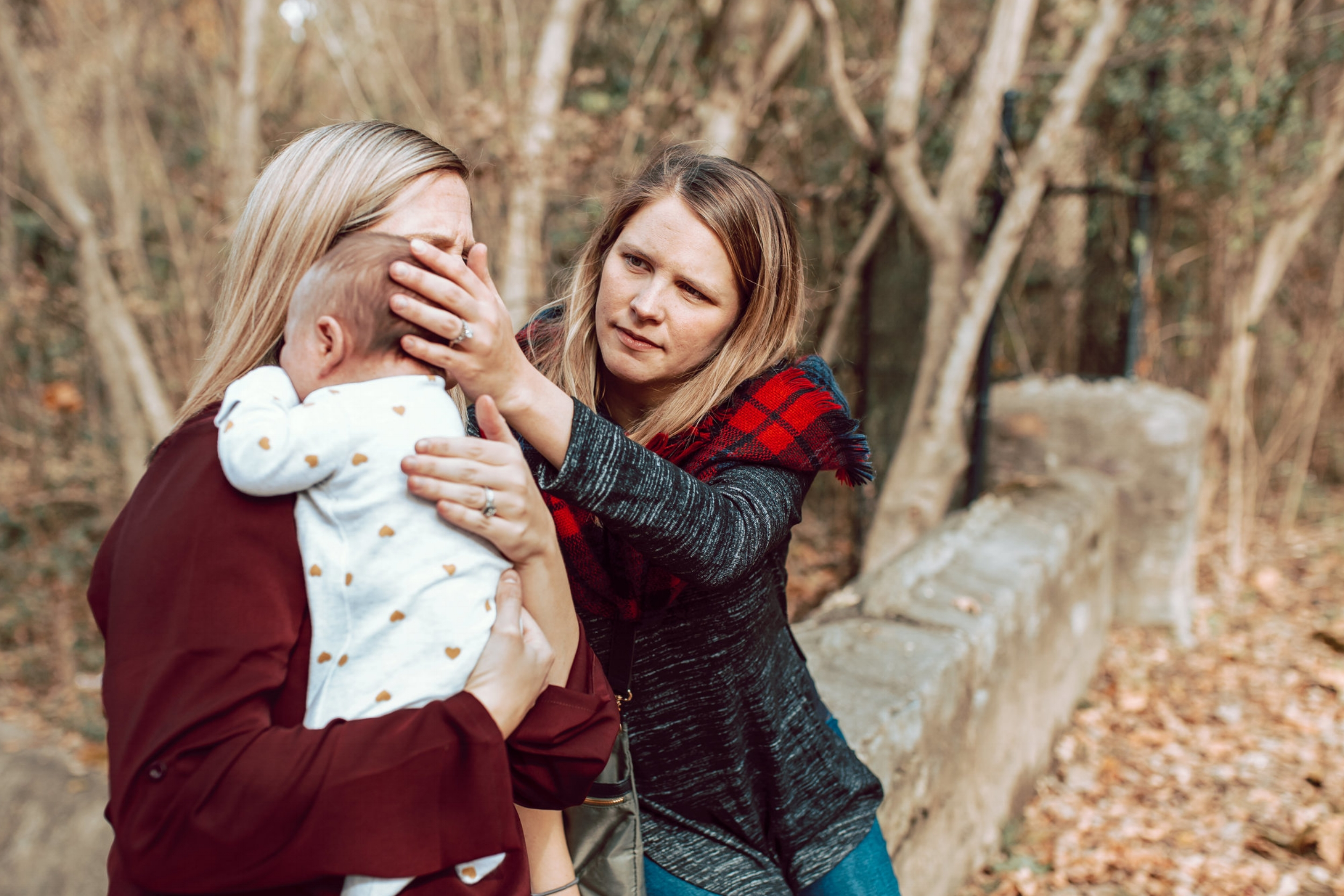 comforting new baby mom and aunt overton park fall memphis