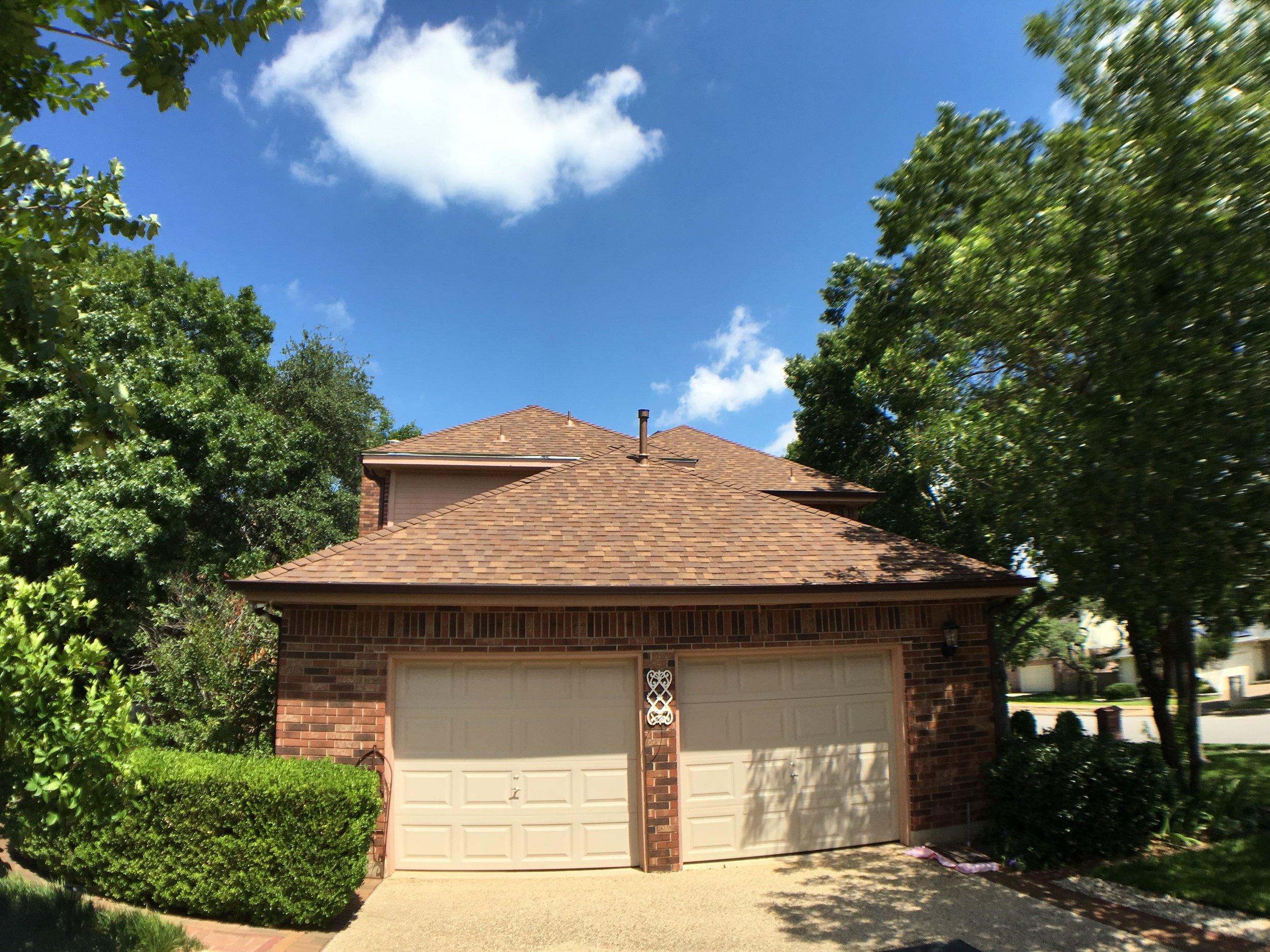 Replaced Roof & Gutters. Roofing Material: Owens Corning, Aged Cedar