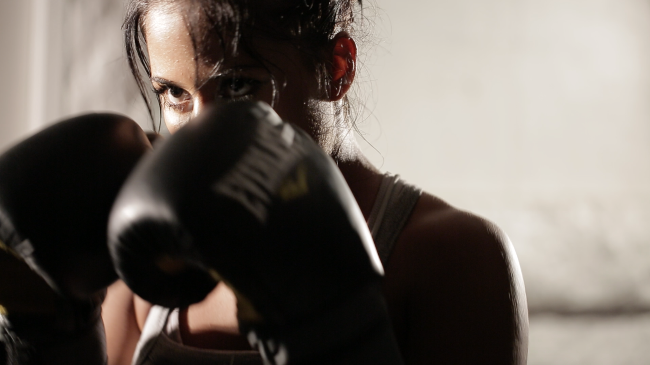 female boxer training in class
