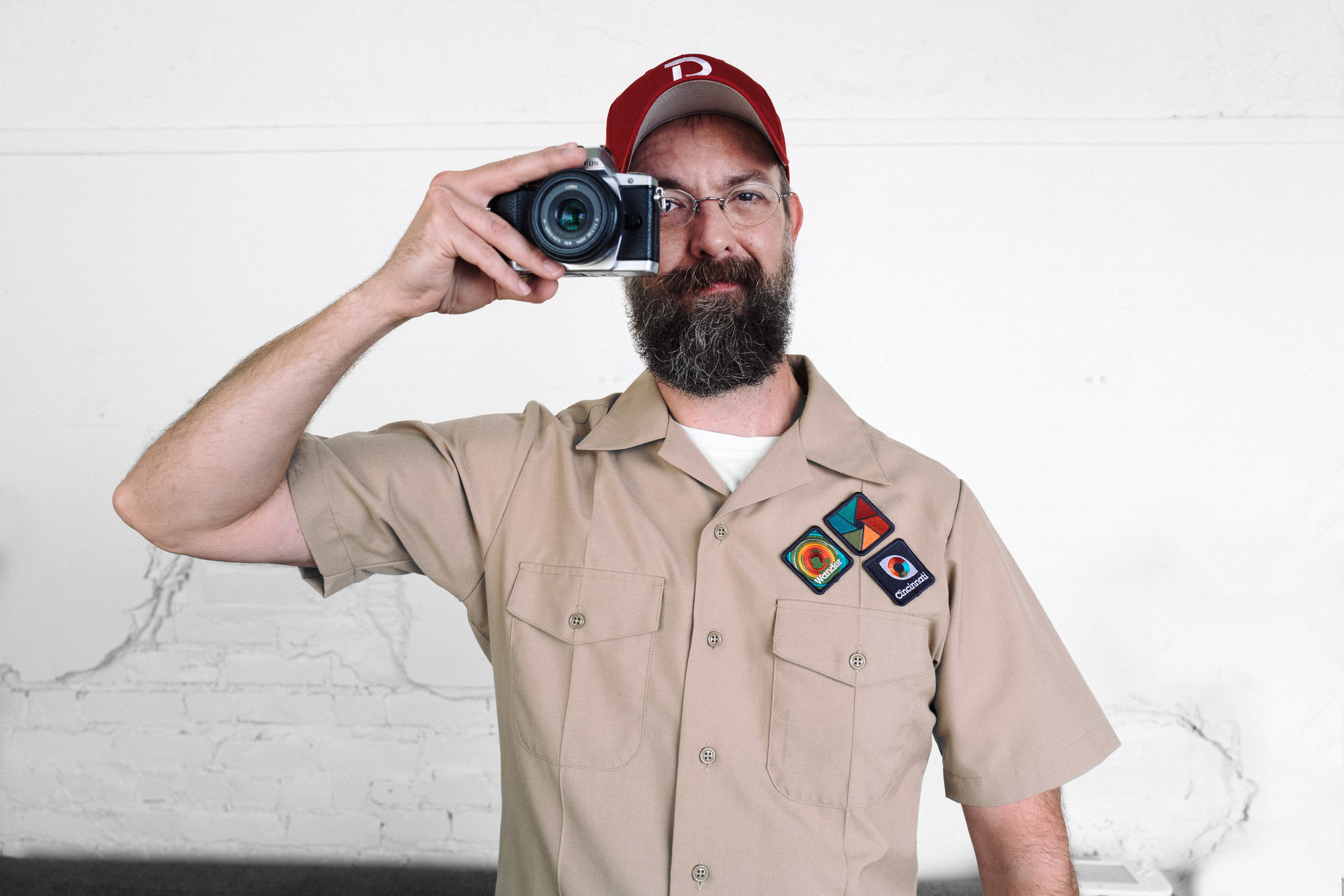 Chris Glass wearing the badges of PhotoScouting.  Photo by Joe Mesa