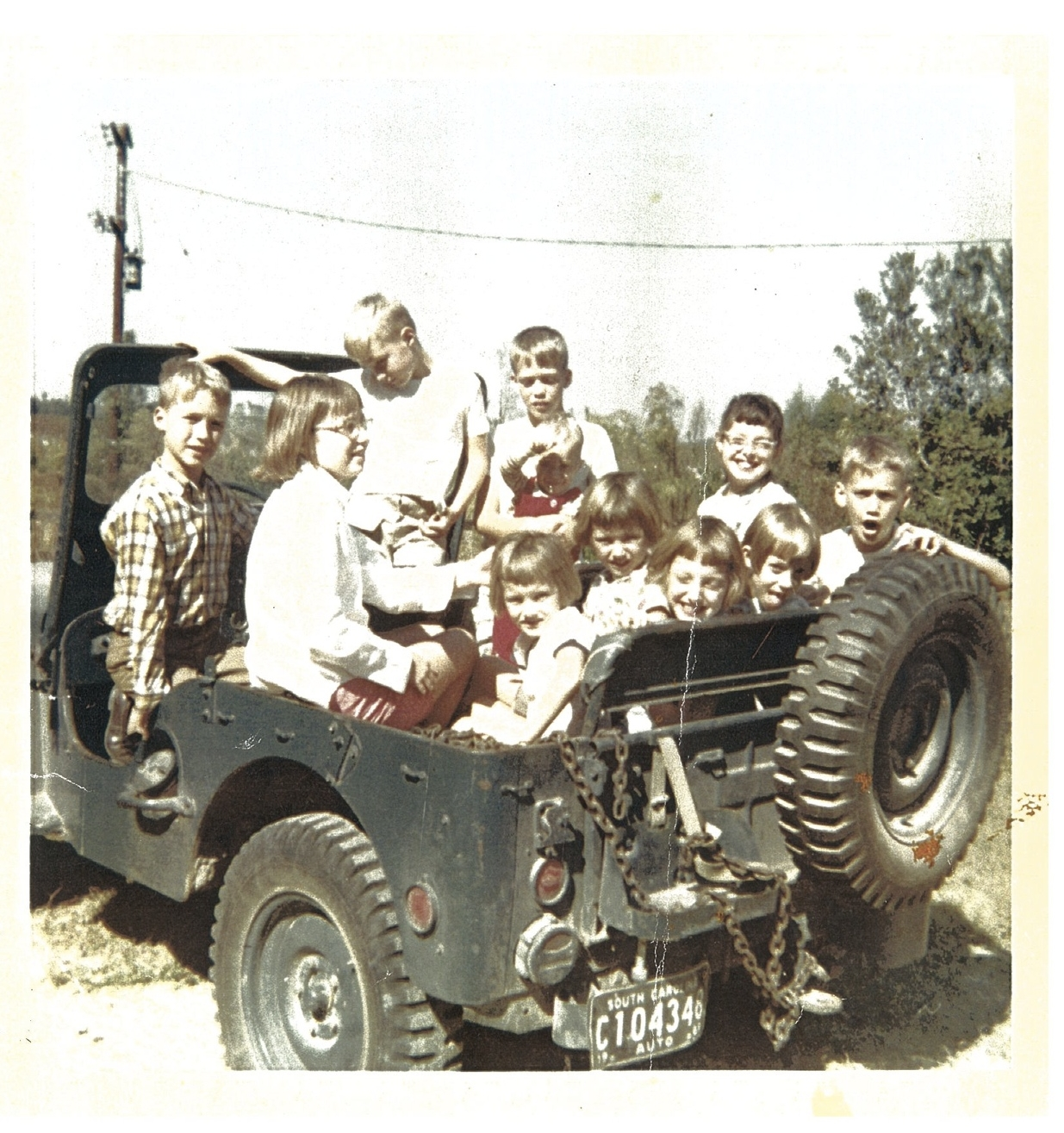 And here we are, all packed in for another farm adventure! Circa 1968  --just a guess.