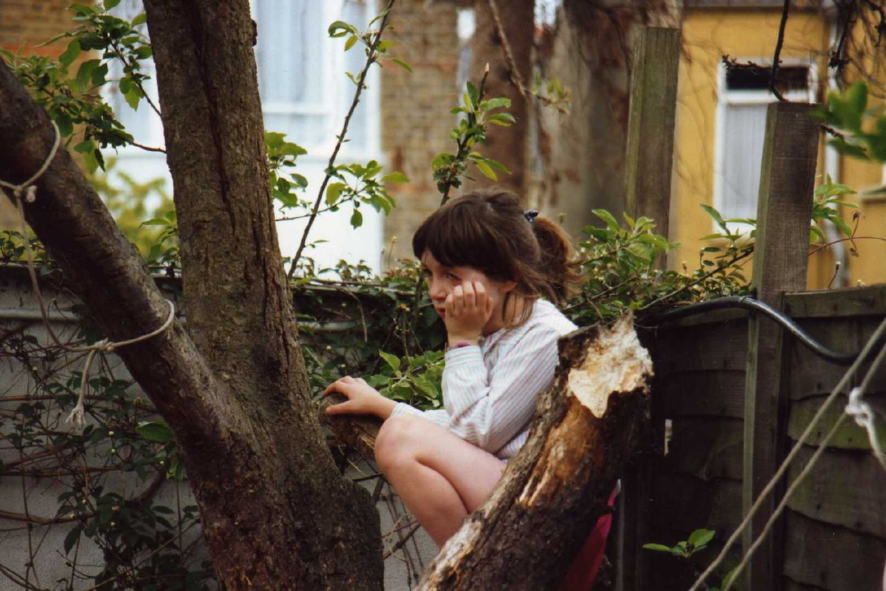Six years old and lost in thought about why we couldn't turn our dying apple tree into a tree house.