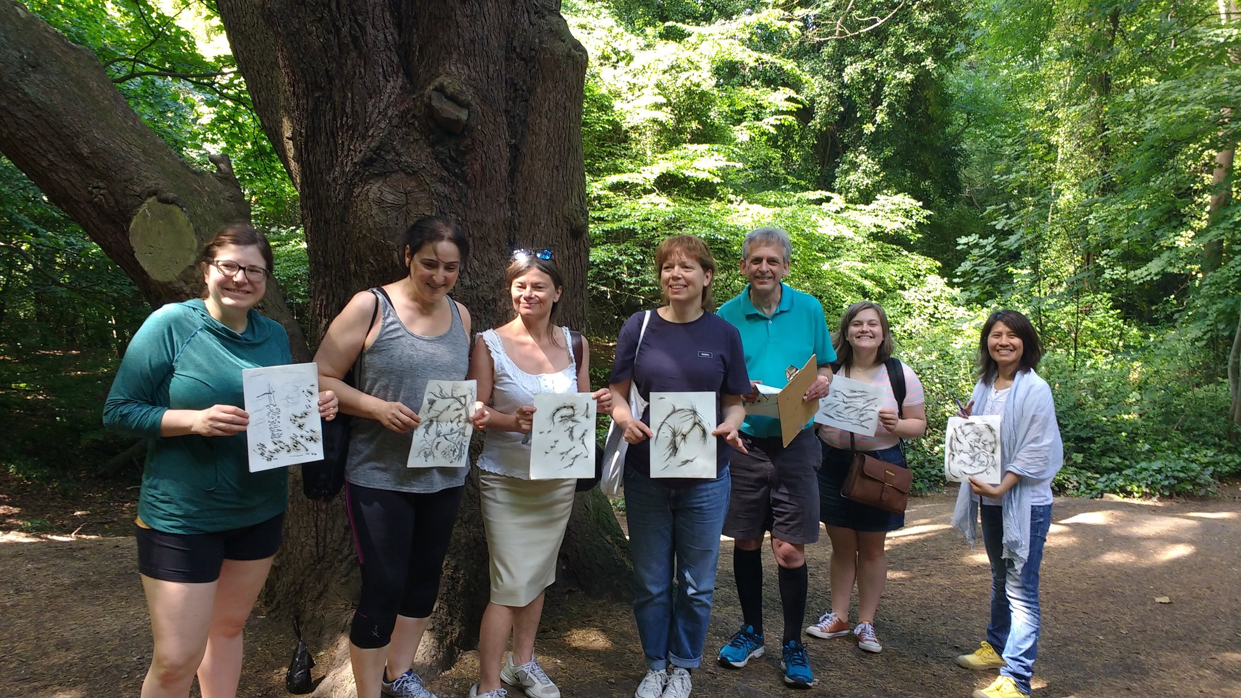 Oak ink impressions and happy faces in Sydenham Hill Wood, after attending a forest bathing session made for the Mayor of London's Tree Week