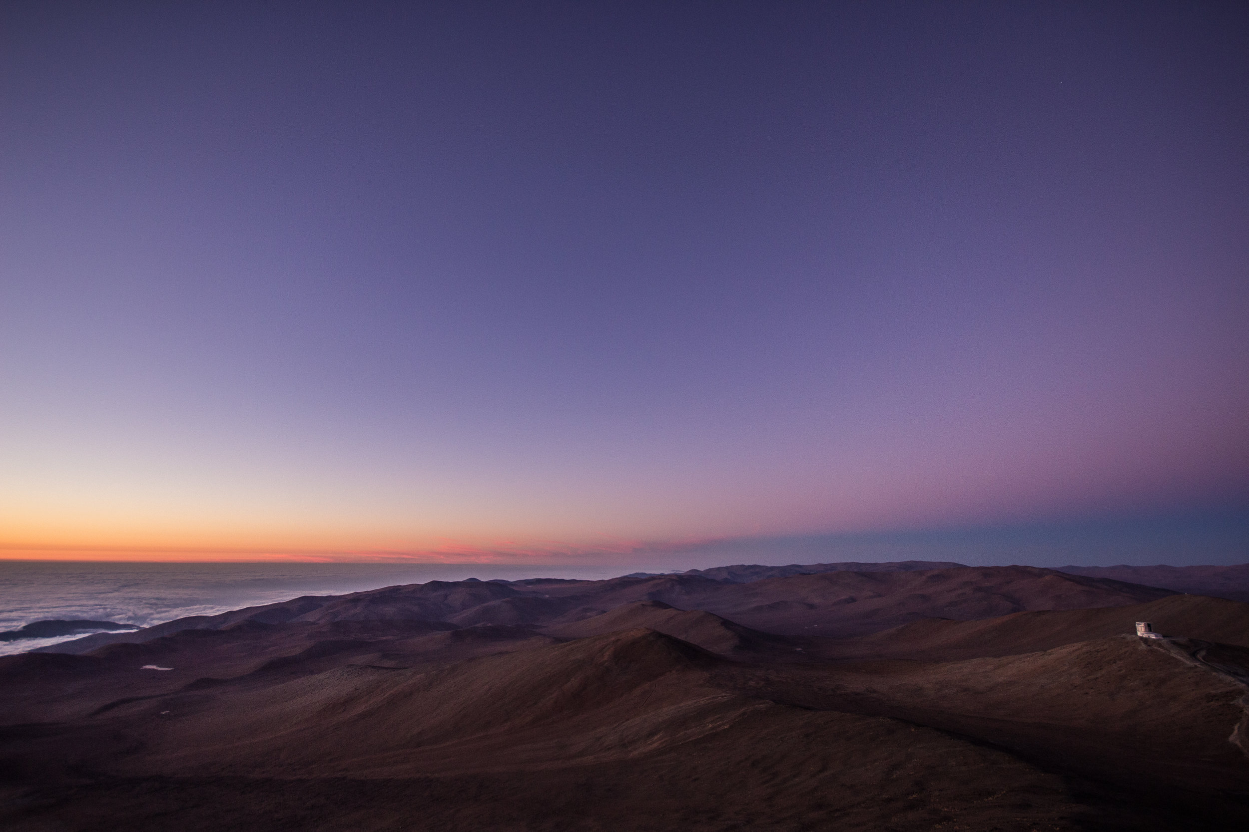 The  shadow of the Earth  is clearly seen on the right. The telescope in the distance is  VISTA , also part of ESO's Paranal Observatory © Dr. Grant Tremblay