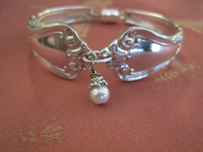 Silver plate spoon bracelets with a selection of pearl or Swarovski crystal accents.