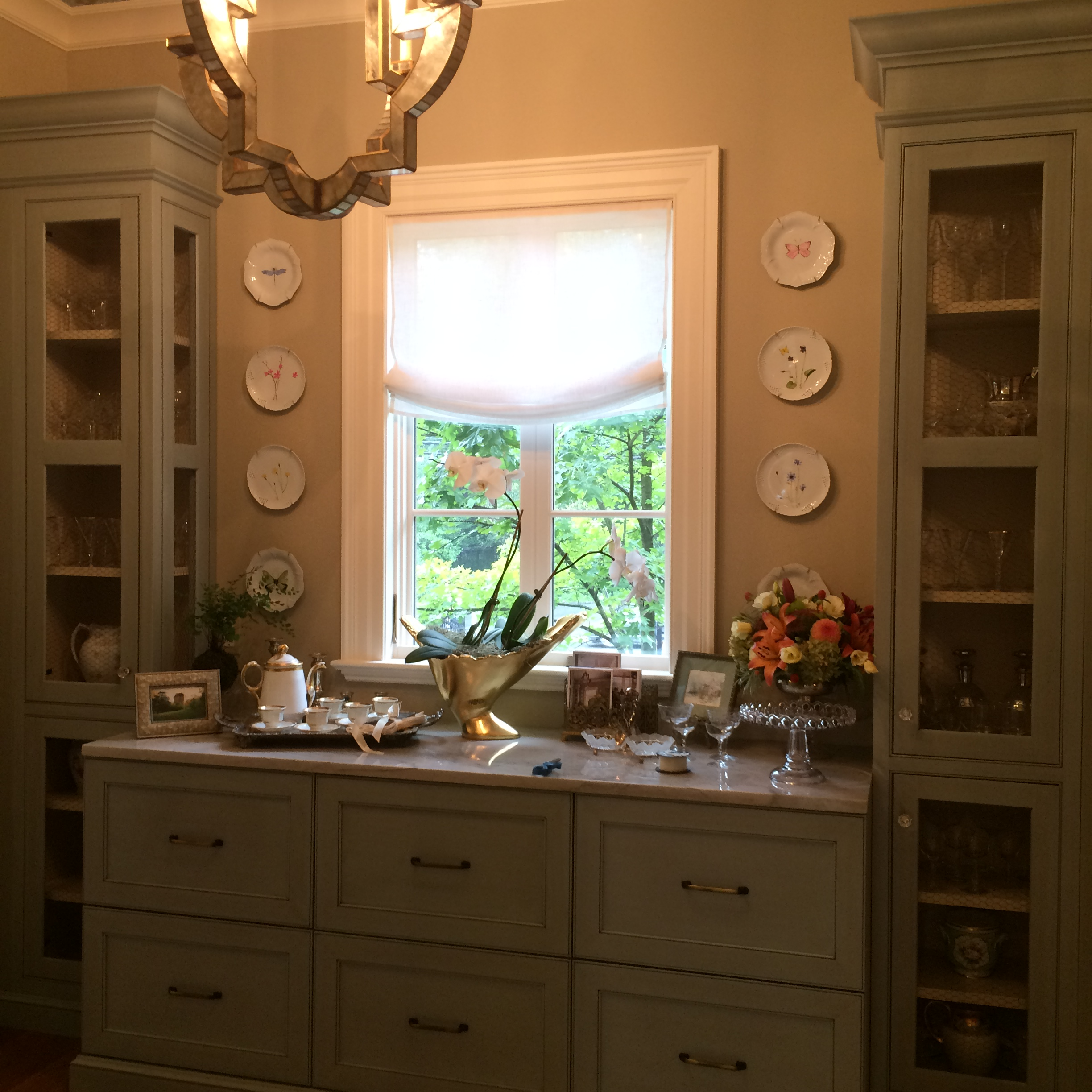 Cabinets and counter top with a glimpse at Aidan Design's truly amazing lighting.