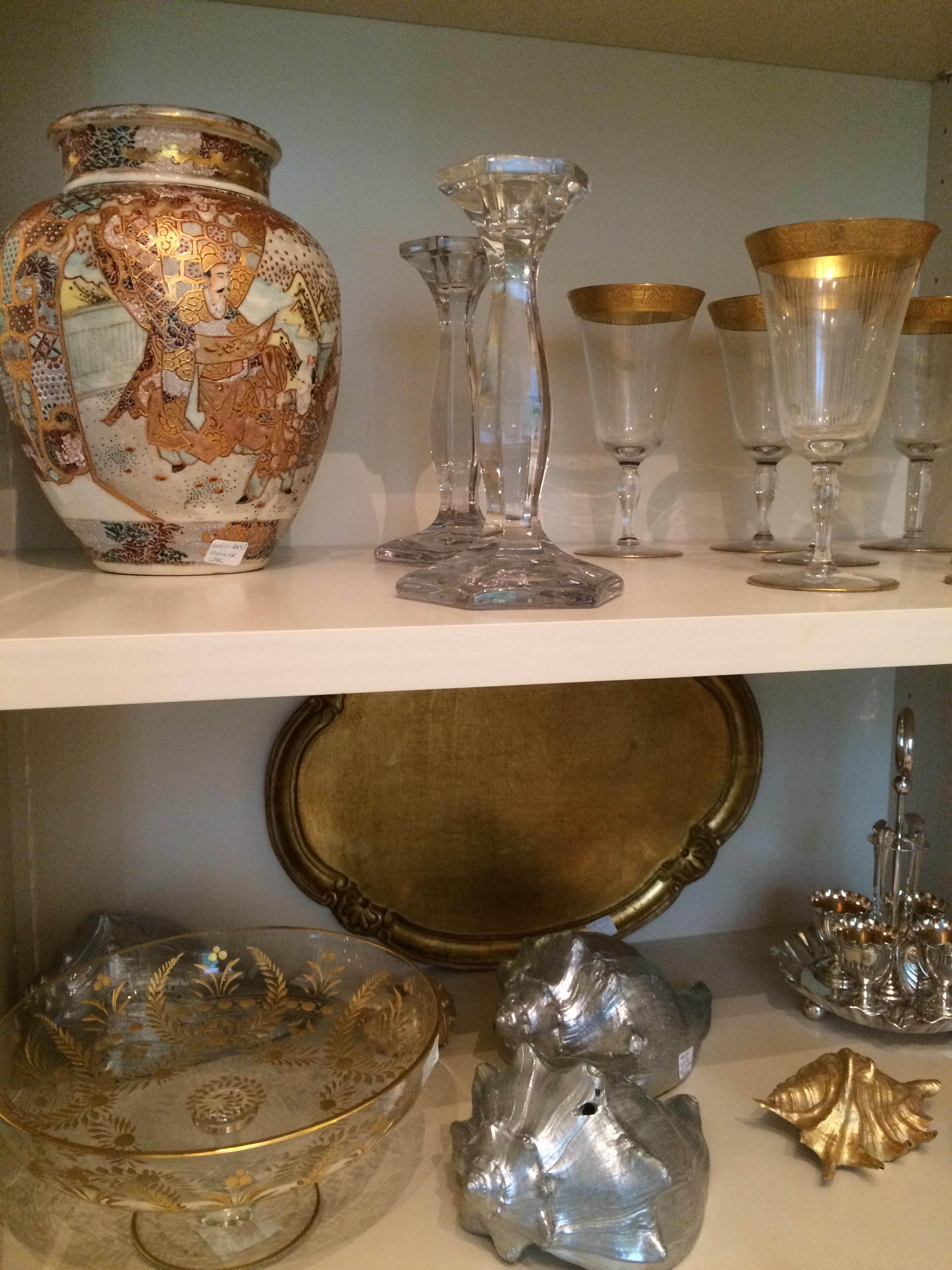 A ginger jar, candle sticks, gold rimmed stem ware, gilt trays and etc