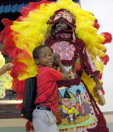 Anthony Reddix, member of the Creole Wild West Mardi Gras Indians, with Langston Hughes student Tyson Jones. Photo courtesy of The Times-Picayune.