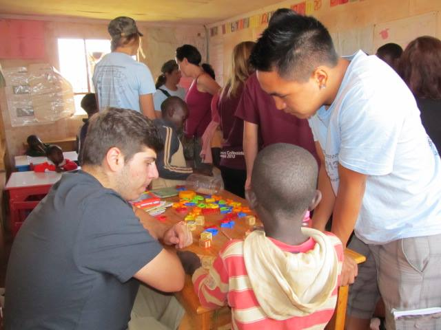 Maples students checking out the nursery school at Mama Tunza Children's Centre.