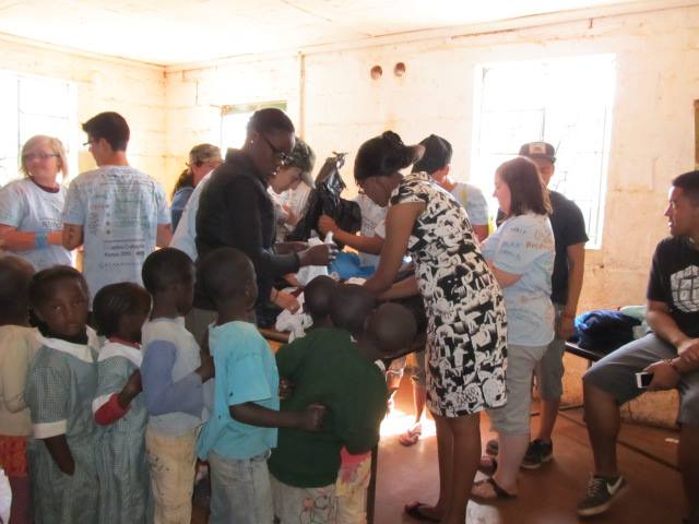The giving continues...The Maples Kenya Connection Group donated clothing, shoes, socks, etc so every child at the centre received something today… Just keeps getting better!