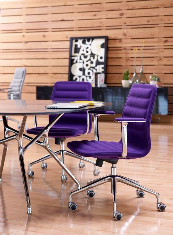 The Haworth Collection/ Cappellini Lotus Chair, designed by Jasper Morrison, looks bold and dramatic in an Ultra Violet fabric.