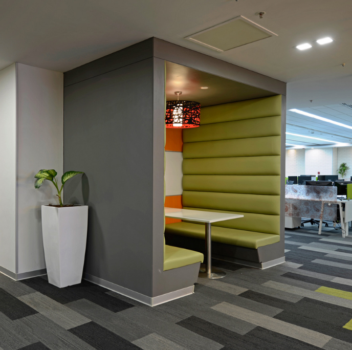 The semi-private space is typically designed with furniture pieces that have higher partions and acoustical properties.