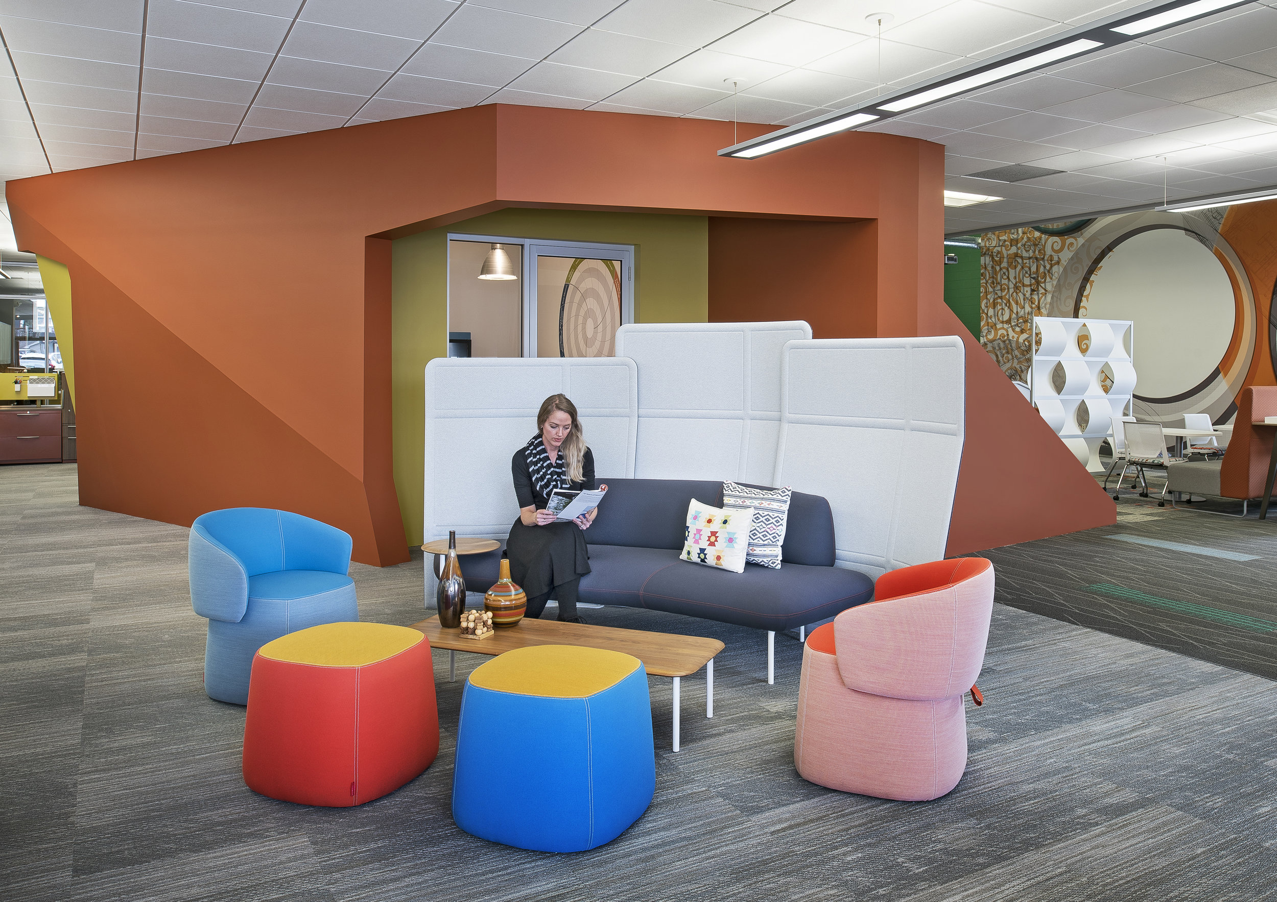 Updated comfortable seating adds to the on-trend resimercial style. Updated paint and carpeting completely transforms the whole area with fresh colors and patterns.