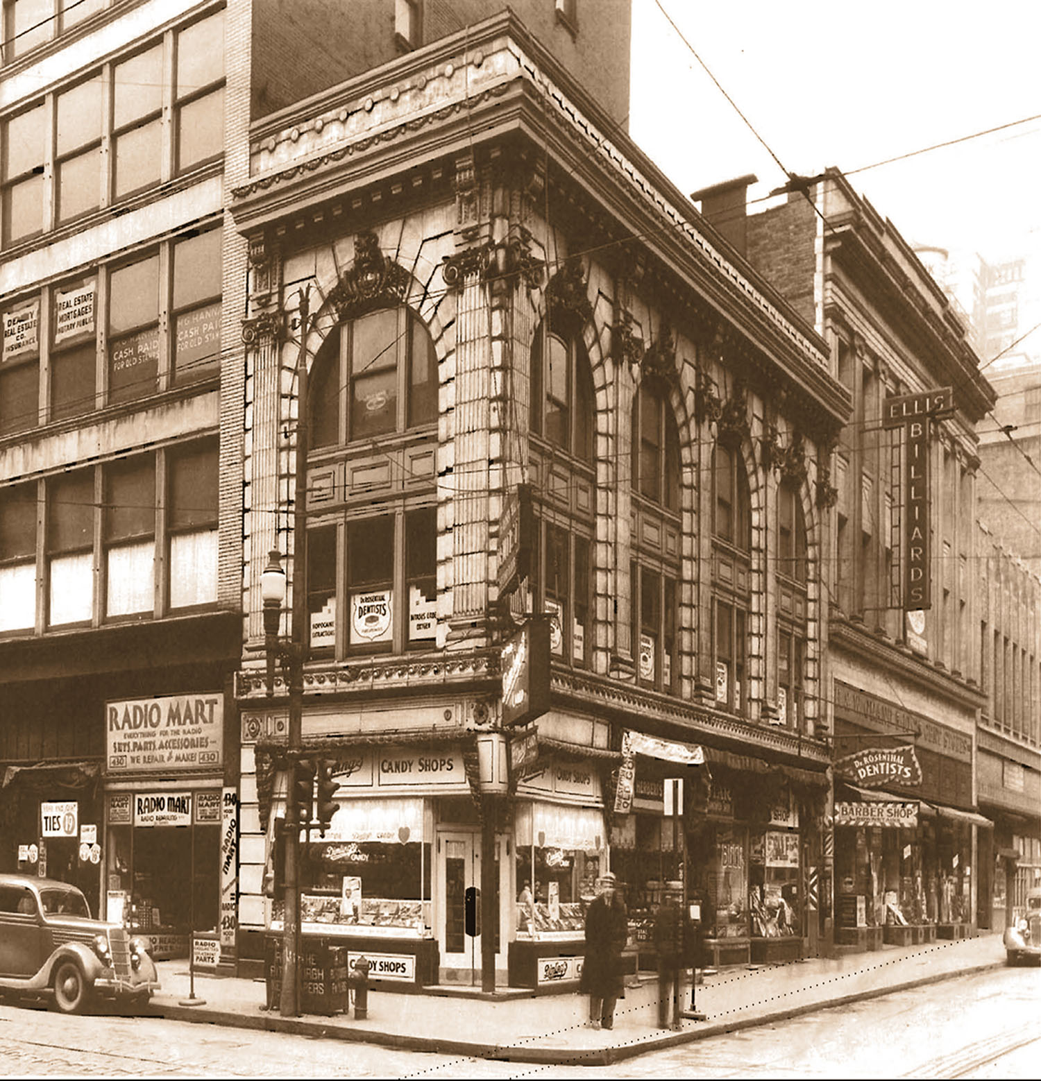 These two buildings, circa 1920, had to be razed to make way for the Tower at PNC Plaza. PNC saved the terra-cotta facade material for later reuse. Most of the material used in making  Earth, Water, Fire, and Air  came from the Ellis billiards hall, on the right.