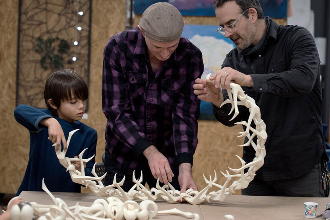 A father and son exploring Cojiform with artist Isaac Bower (center) at the non-profit art and science space, Assemblepgh.