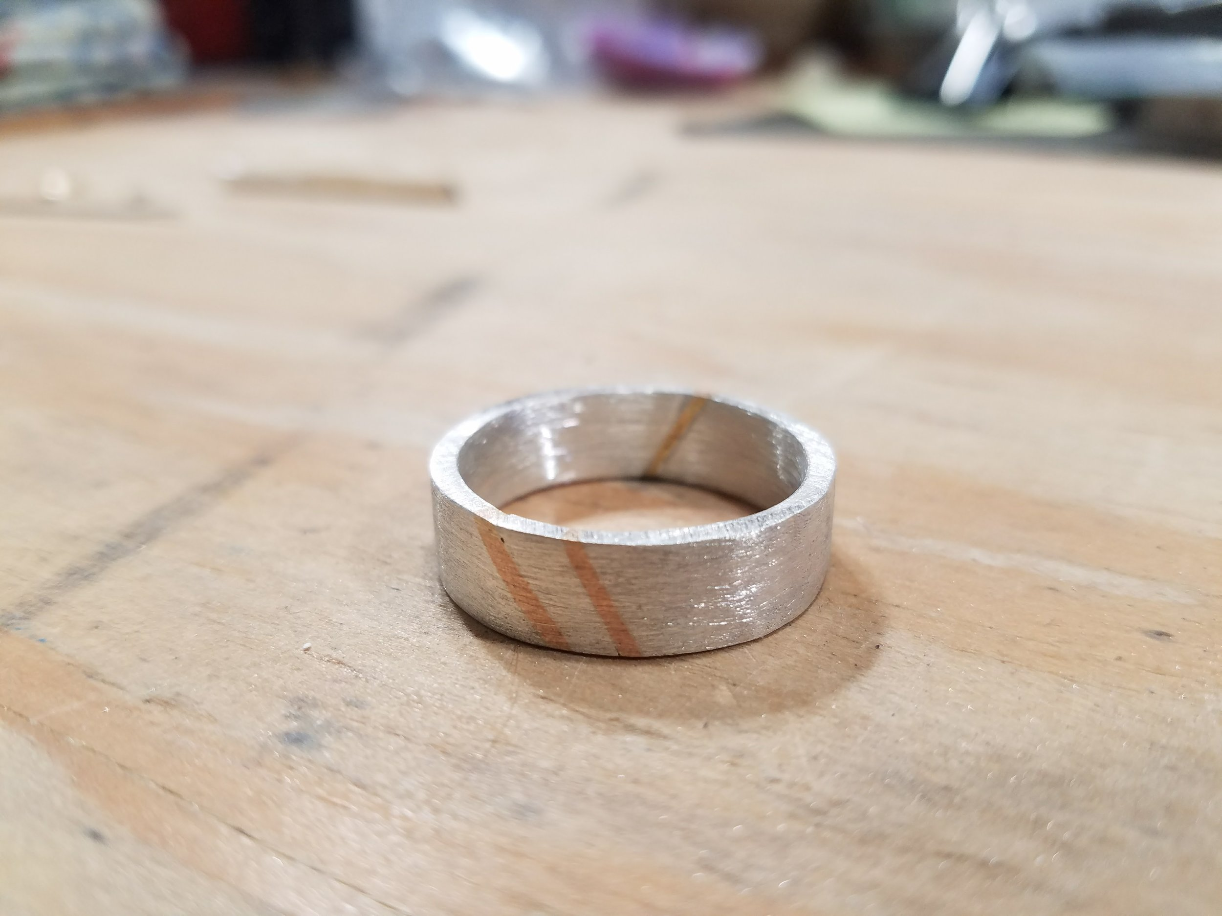 view of mens wedding band in process