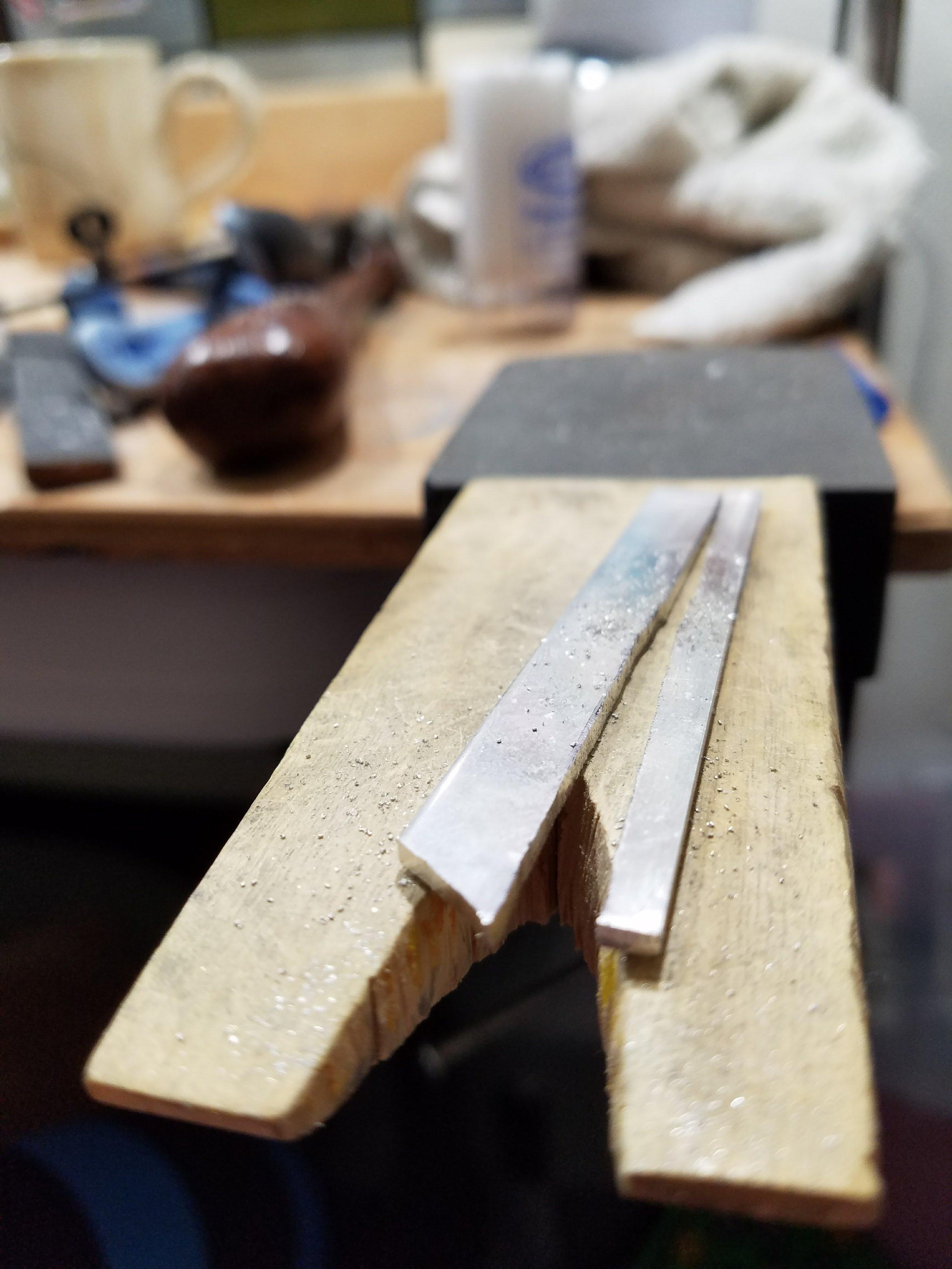 view of 12 gauge sheet metal on bench