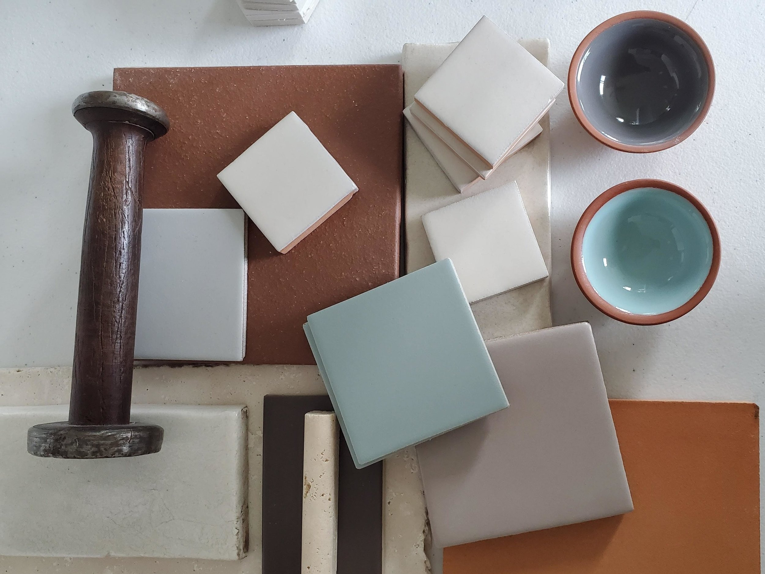 Sam had been sourcing old tiles for a photo shoot and decided they would be the perfect color scheme for her table in their shared booth.