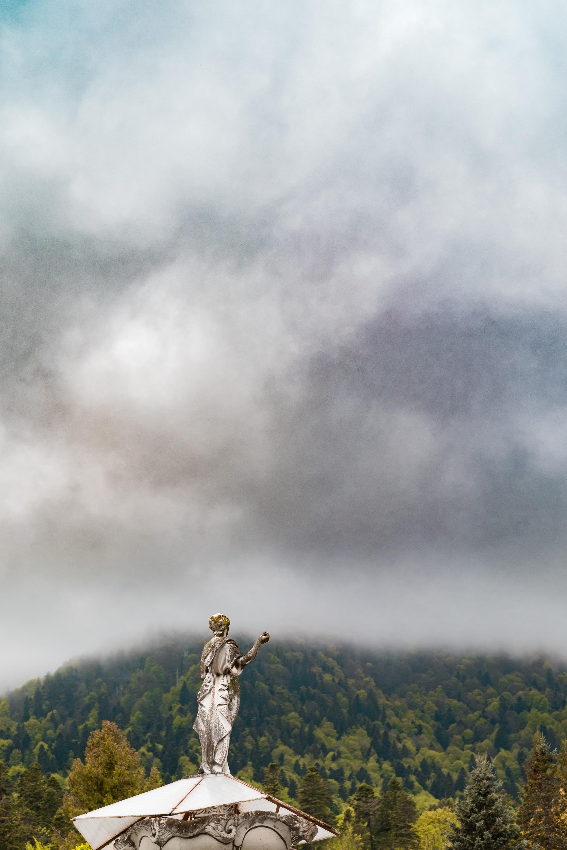 Peles statue in fog