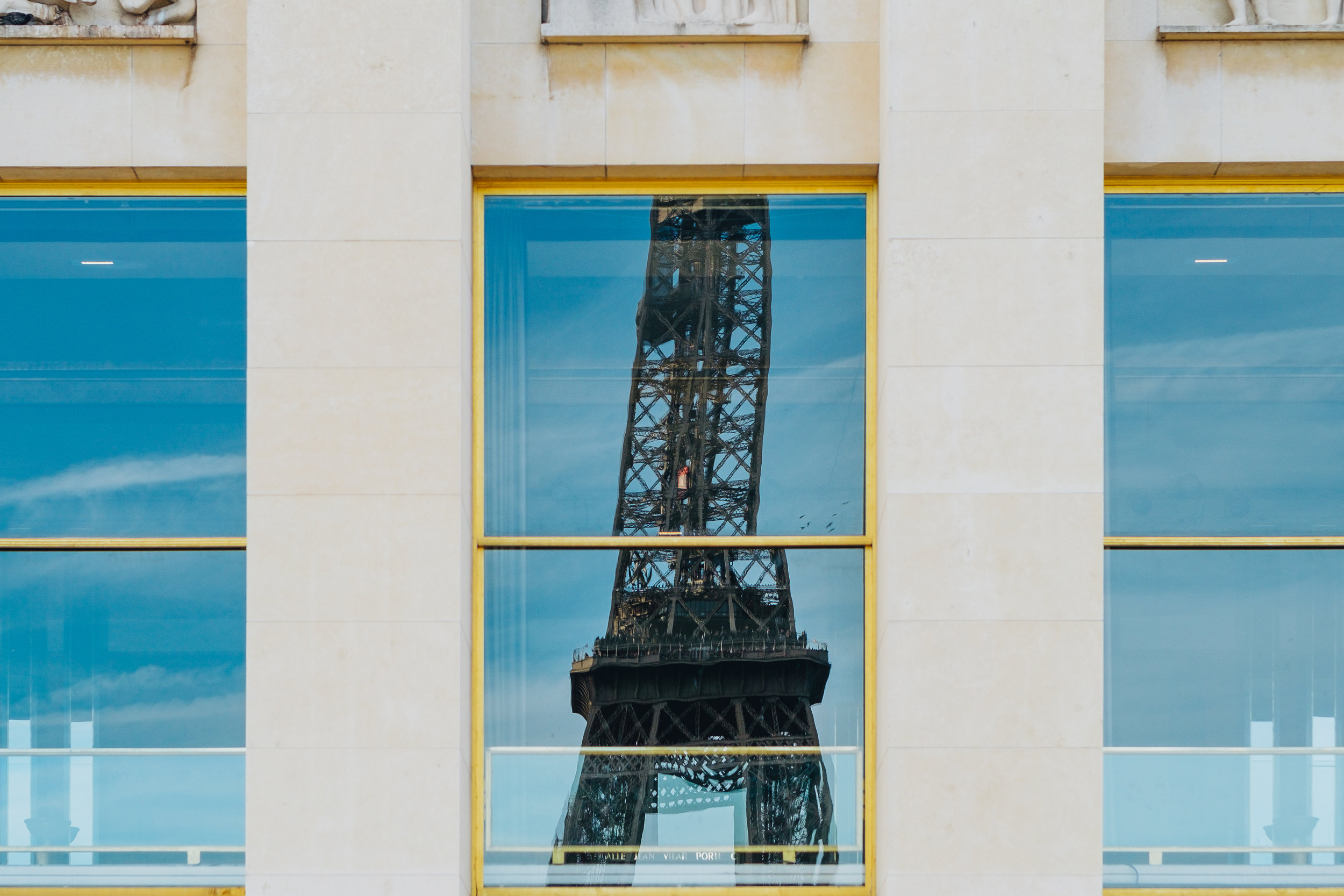 The Eiffel Tower as seen in the reflection of the Trocadero