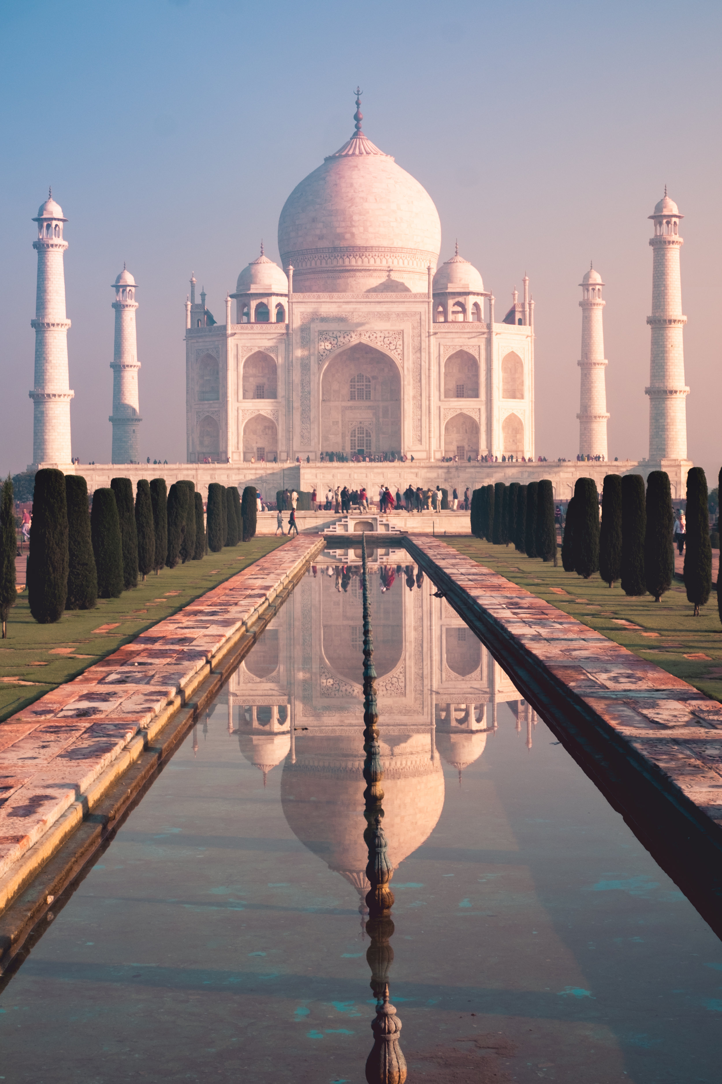 This is a pretty traditional example of leading lines. The reflecting pool, trees, and even minarets lead The Eye to the mausoleum.