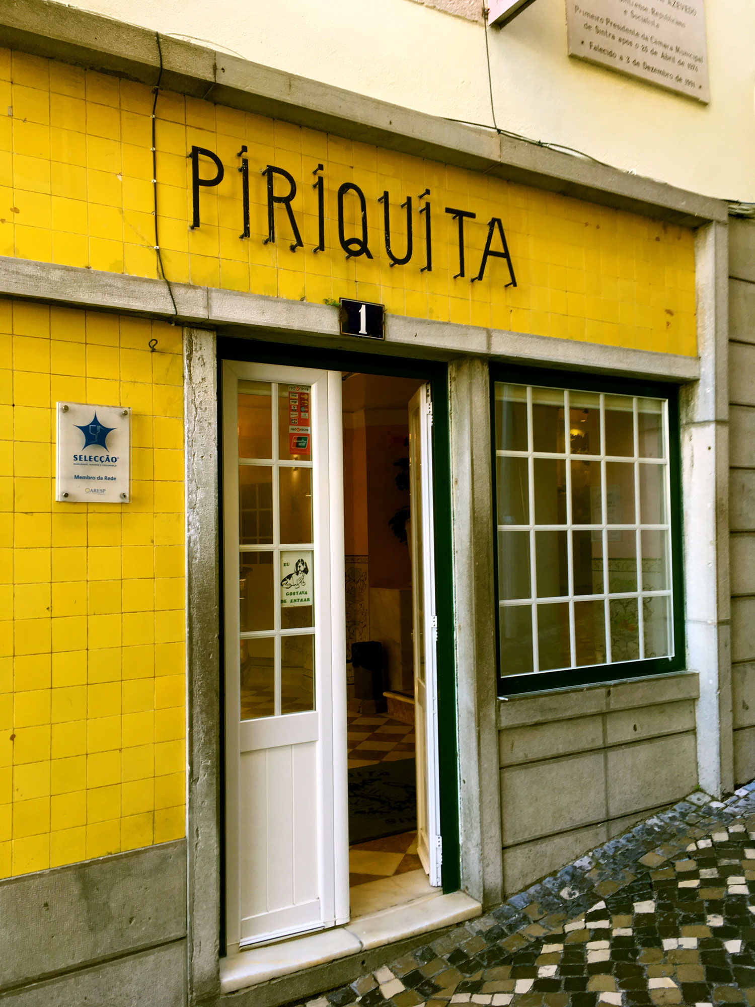 after an overnight international flight, our first stop (once we got to sintra, 2 hours from lisbon airport) was  casa piriquita . We picked up travesseiro, a traditional pastry of Sintra, meaning pillow in portuguese. They are puff pastry filled with almond cream. The bakery has been open since 1862 and provided the perfect fuel for our exploration of the pena palace and moor castle.