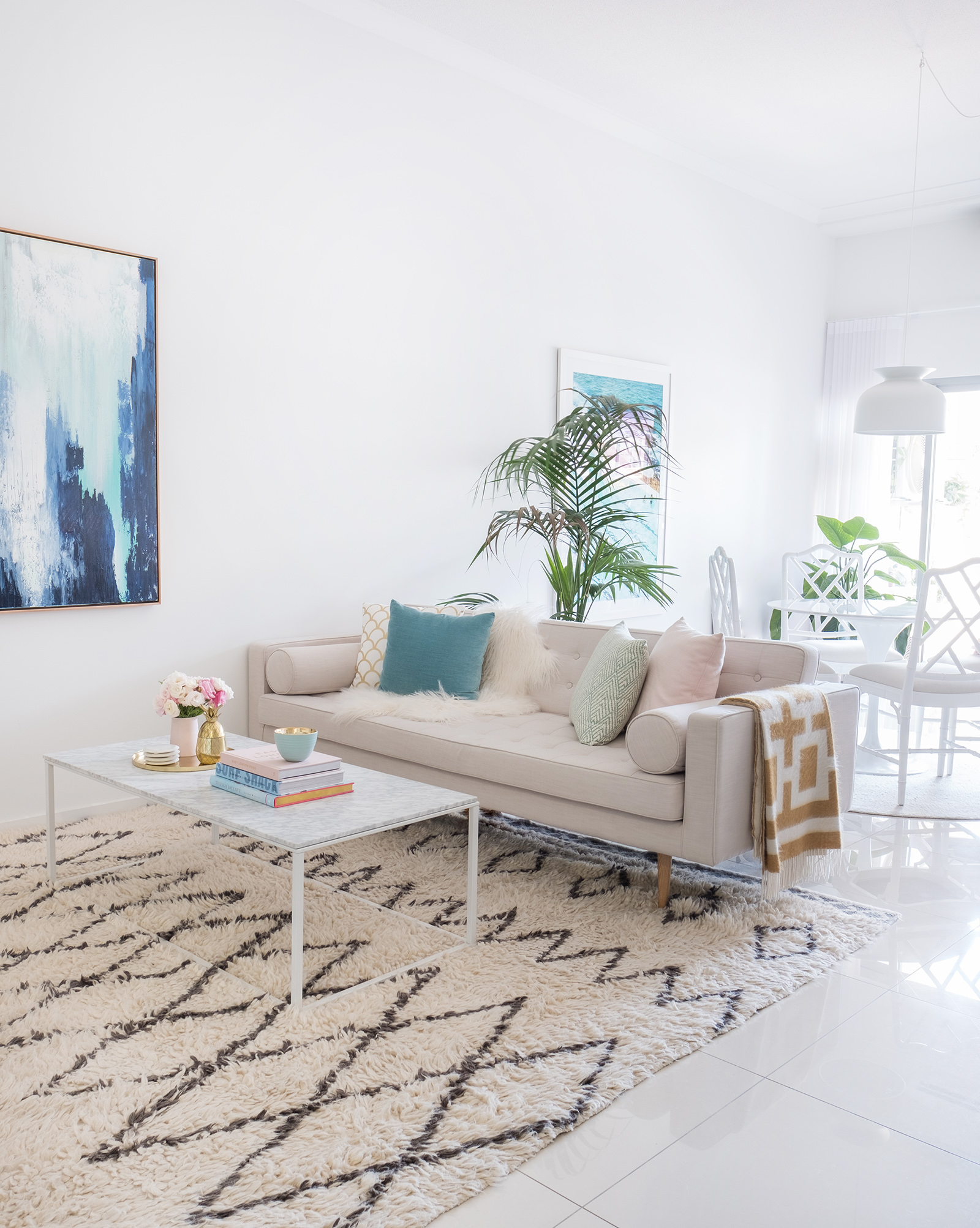 pink_loni_parker_living_room_reveal_globewest_sofa_blu_dot_coffee_table_blue_off_white_interior.jpg