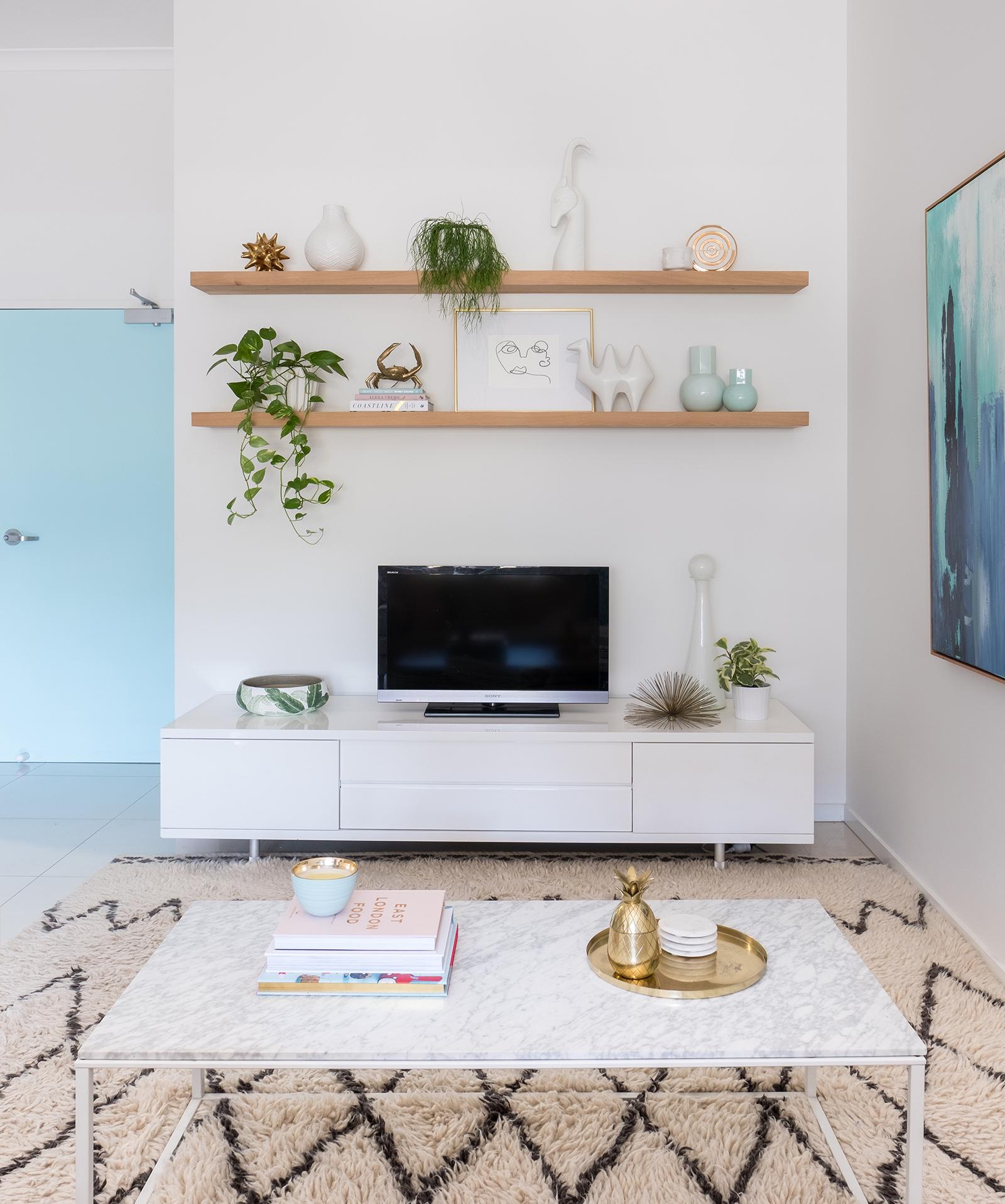 loni_parker_living_room_blue_floating_shelves_clickon_west_elm_rug.jpg