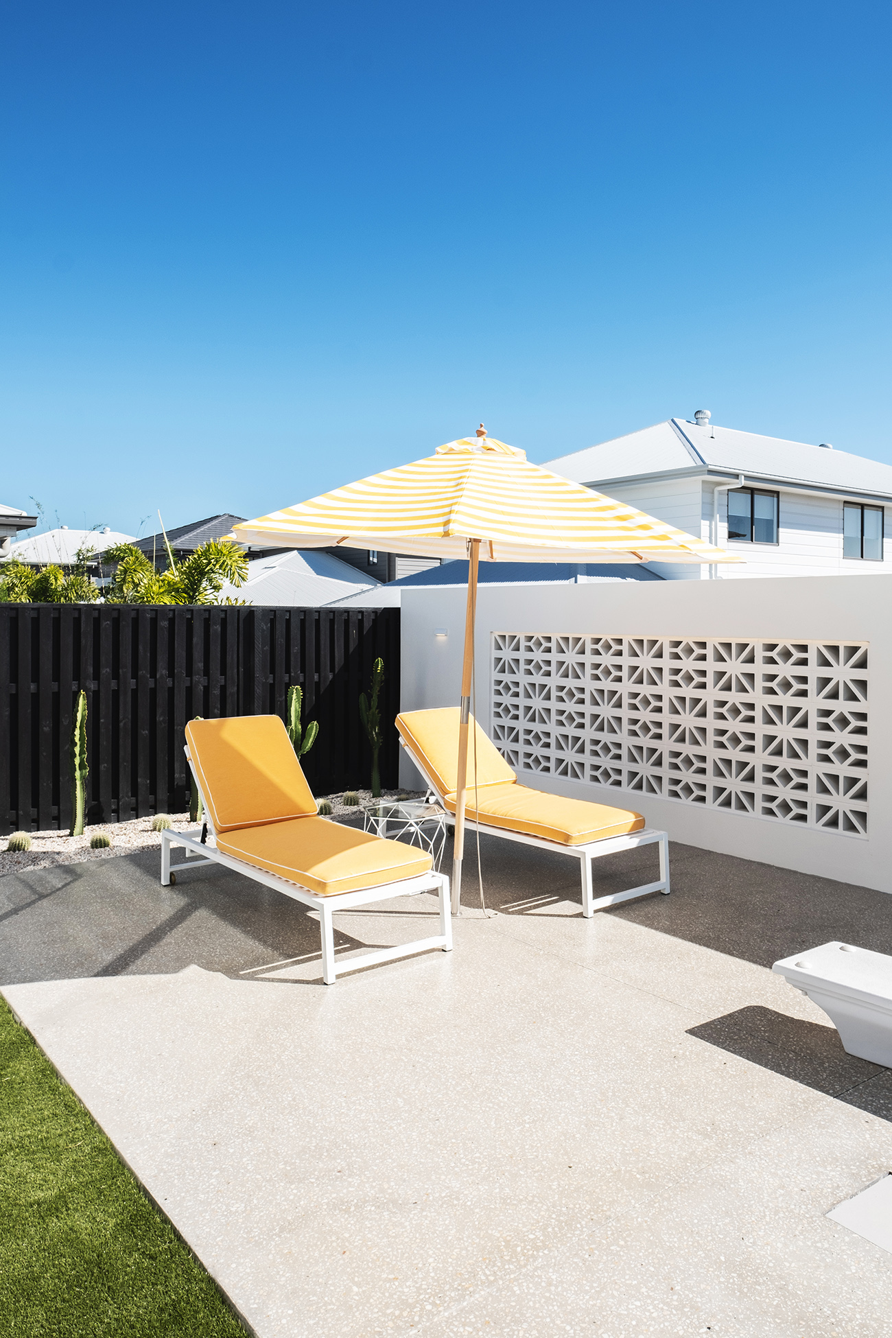 aston_milan_palm_springs_style_outdoor_pool_yellow_umbrella.jpg
